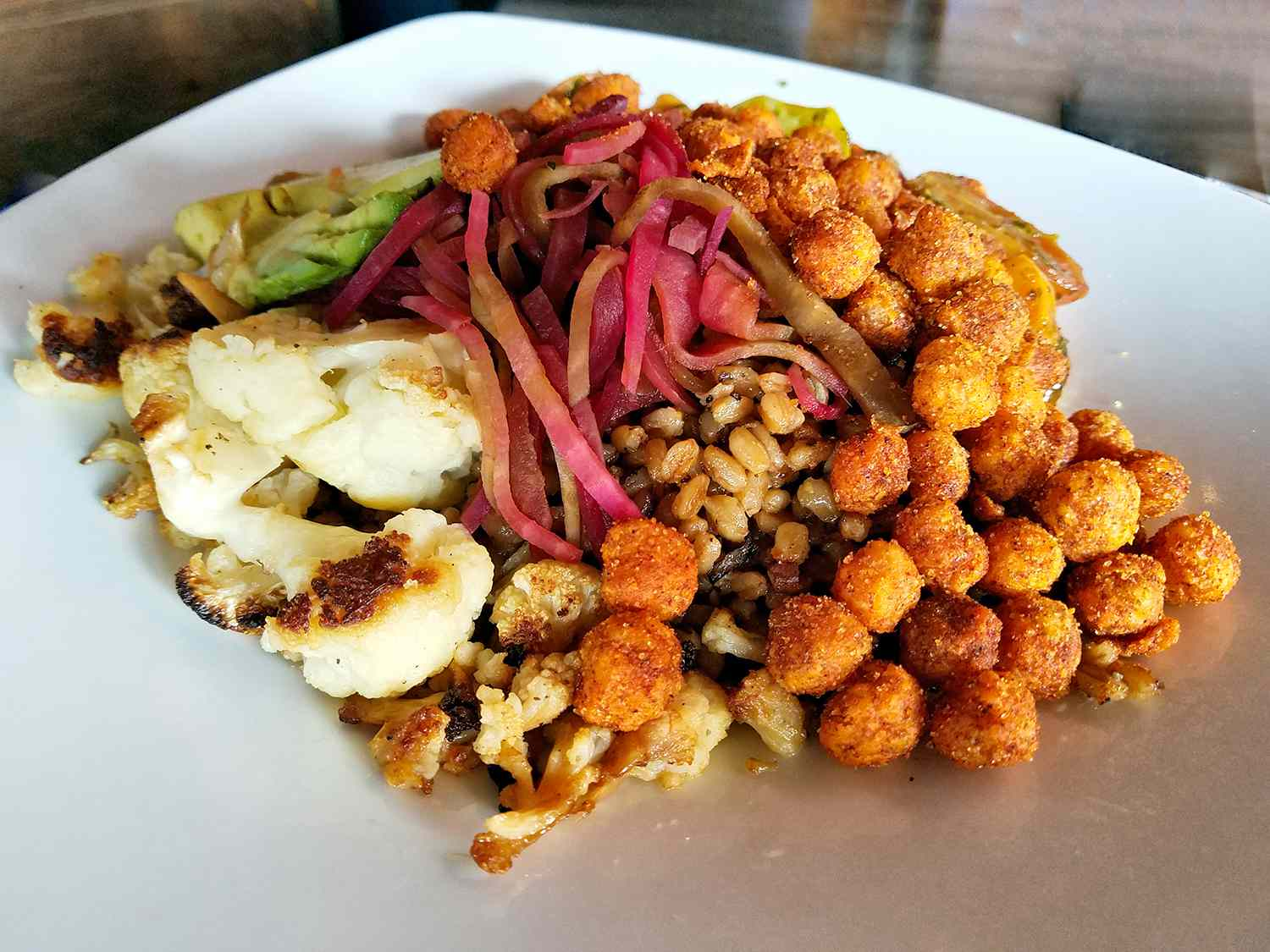 Farro bowl with cauliflower, fried chick peas, and beets