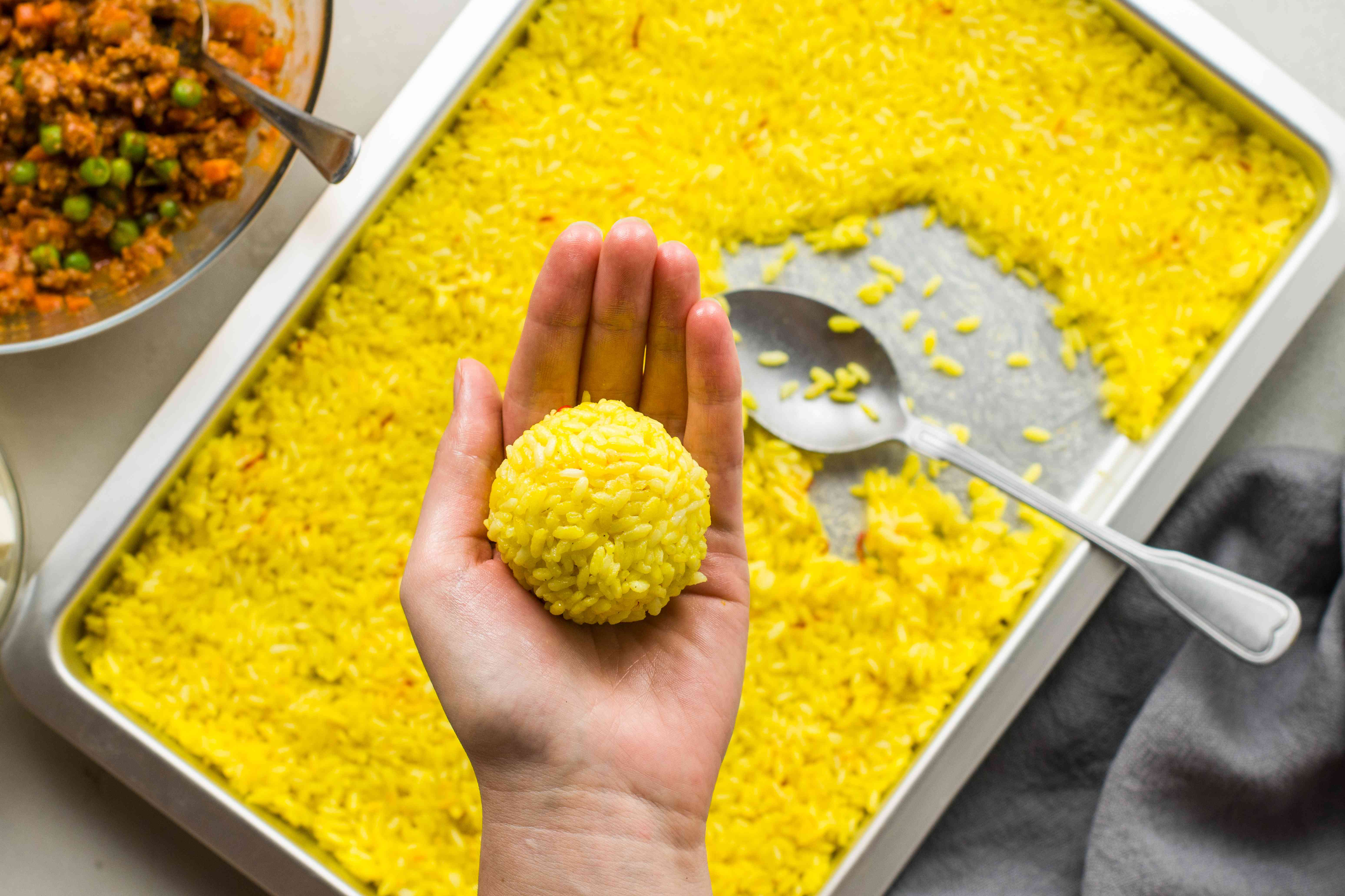Rice formed around the filling for arancini