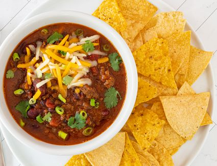 instant pot chili in a bowl with tortilla chips on the side