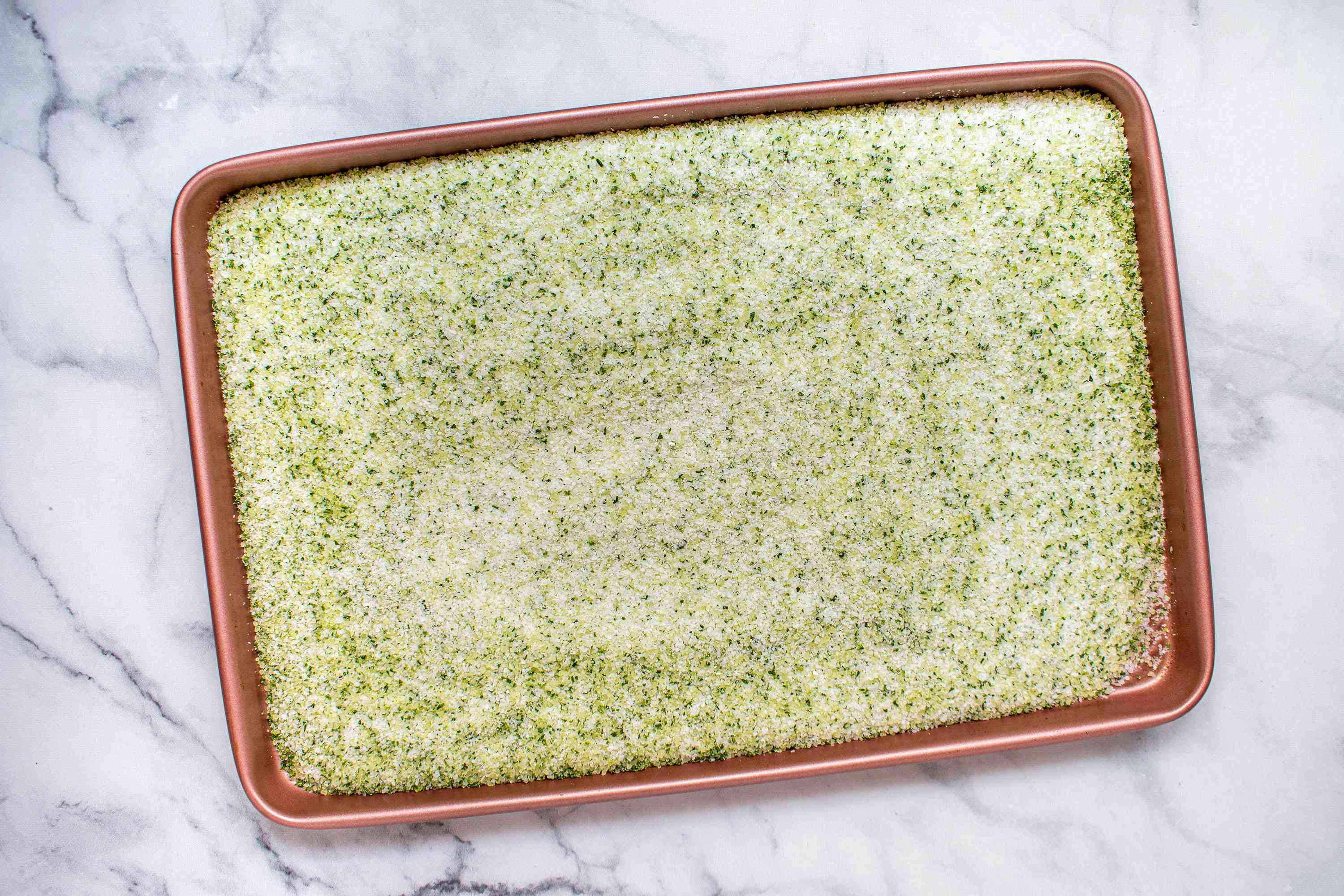 rosemary and salt mixture on a baking sheet
