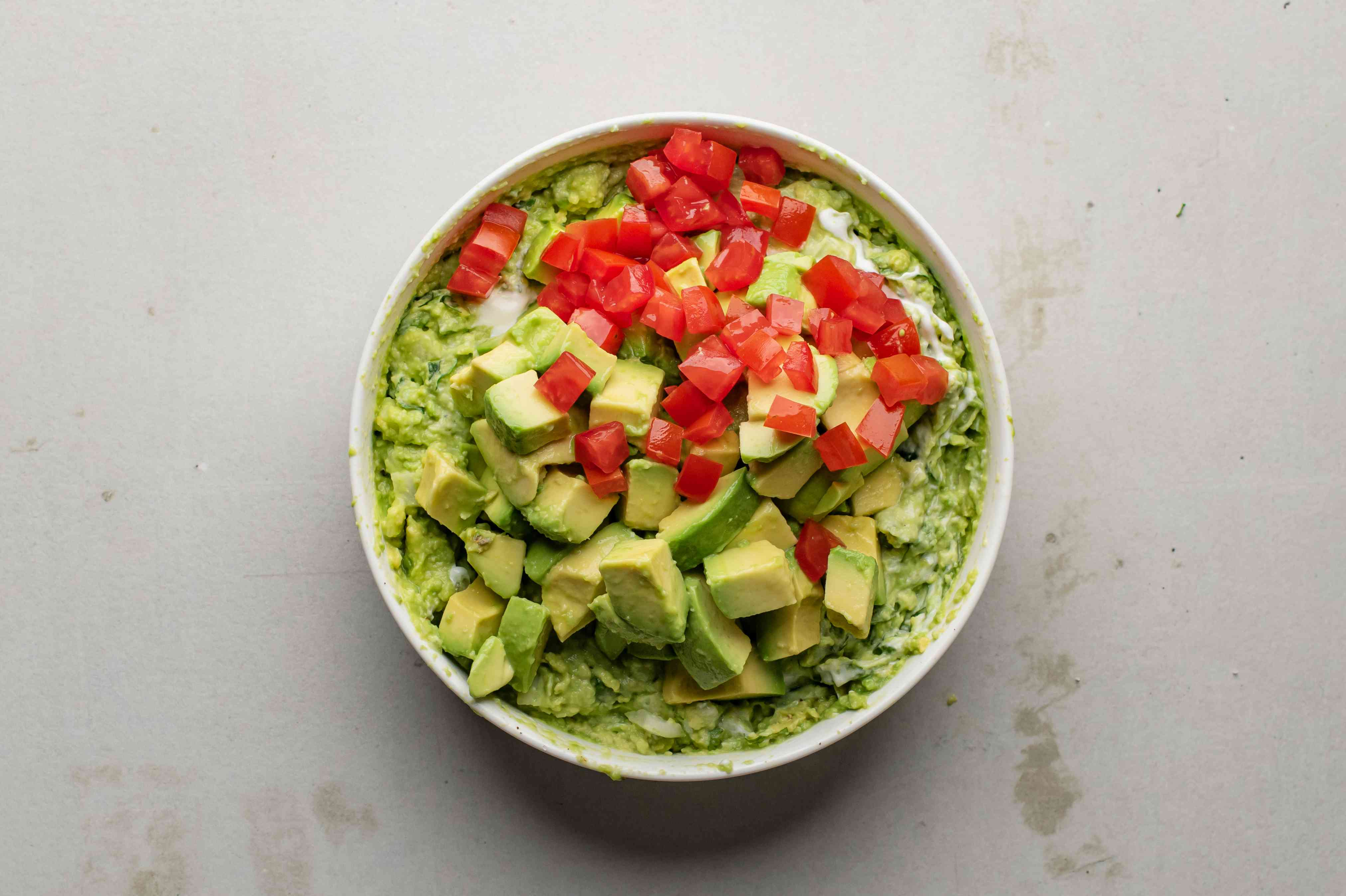 Tomato and diced avocado added to guacamole