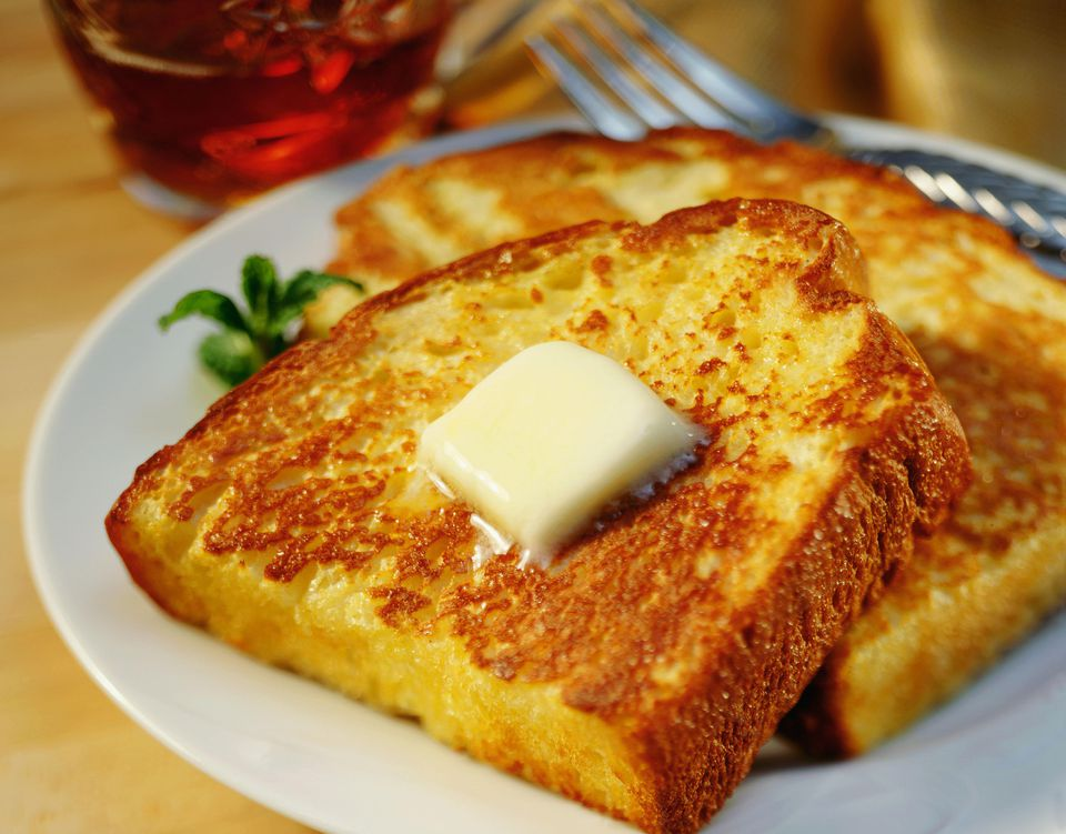 French toast on a dish with a pat of butter