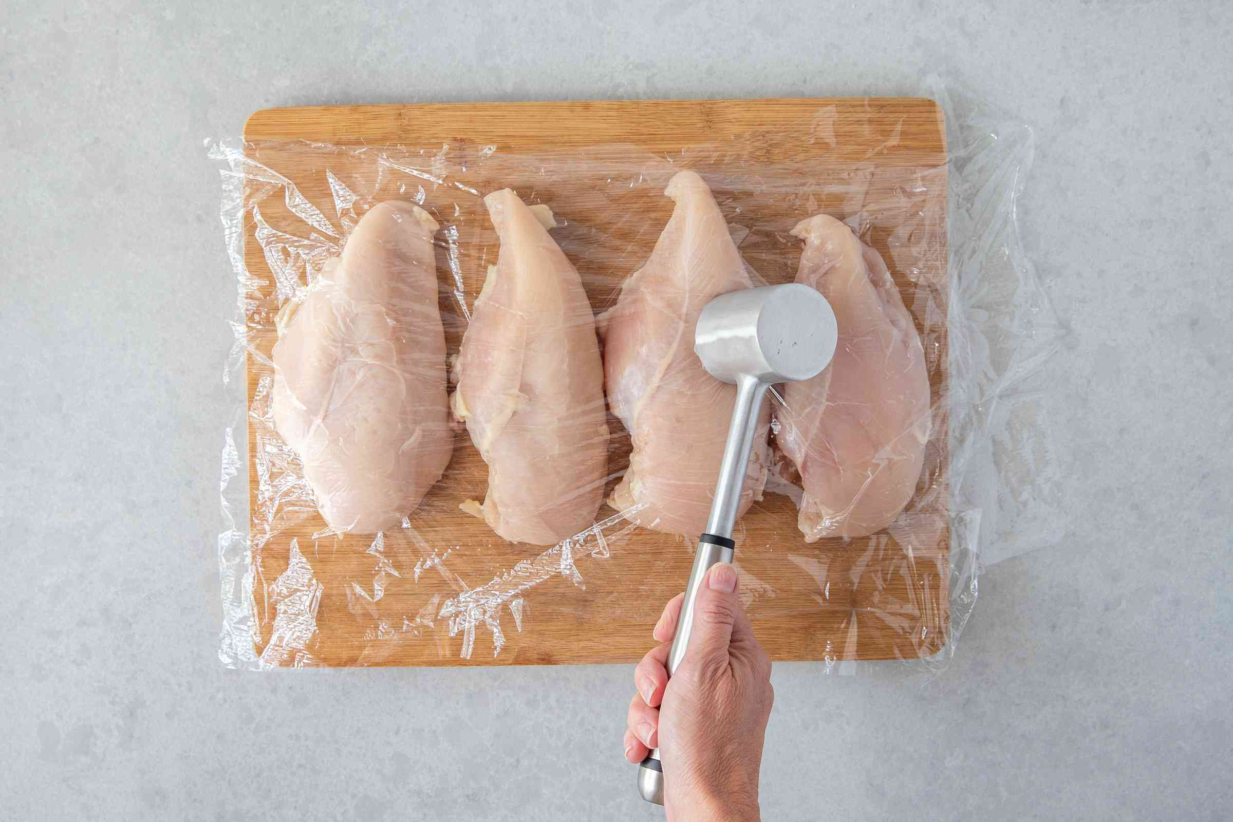chicken pounded between plastic wrap