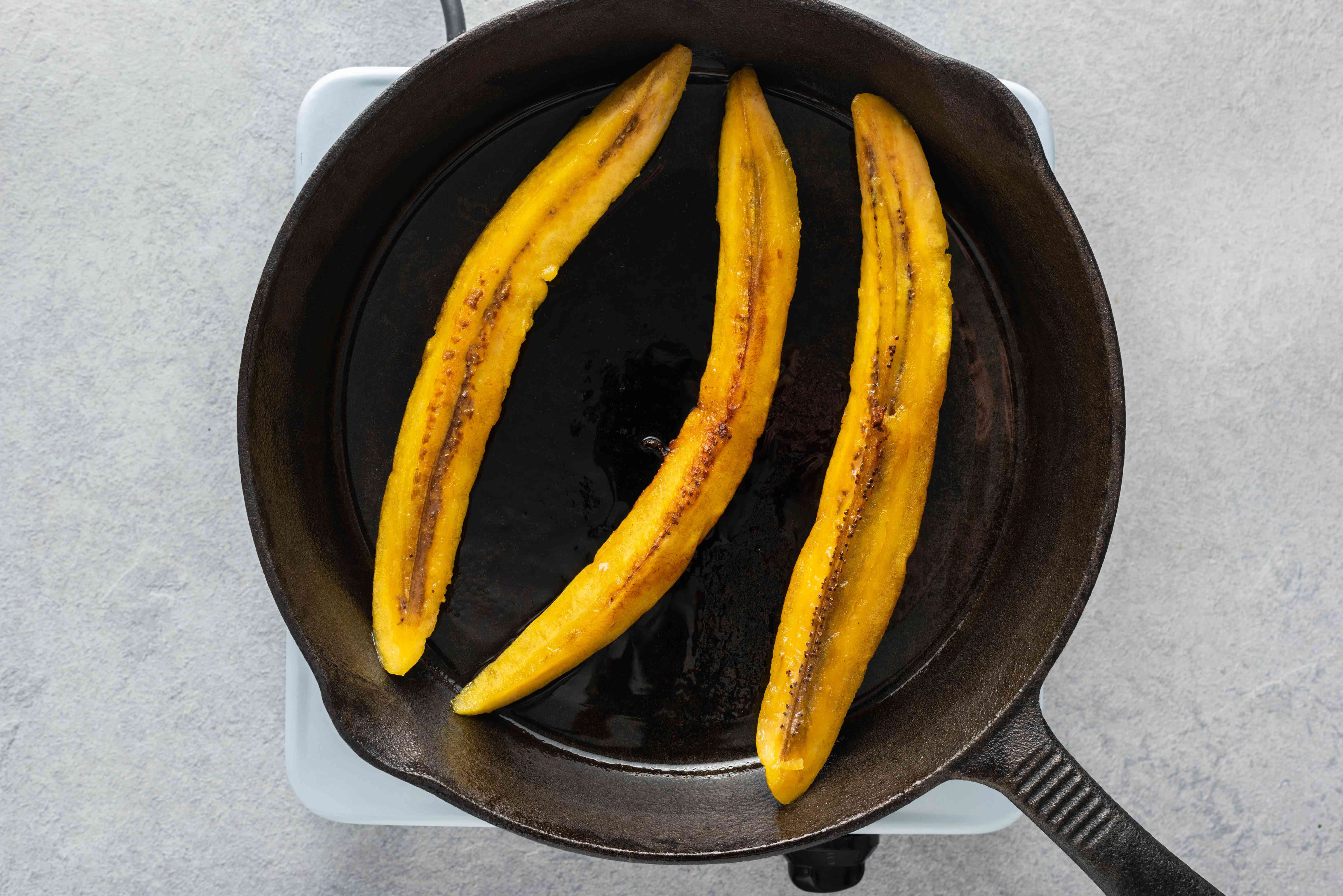 fry plantain pieces in a skillet with oil