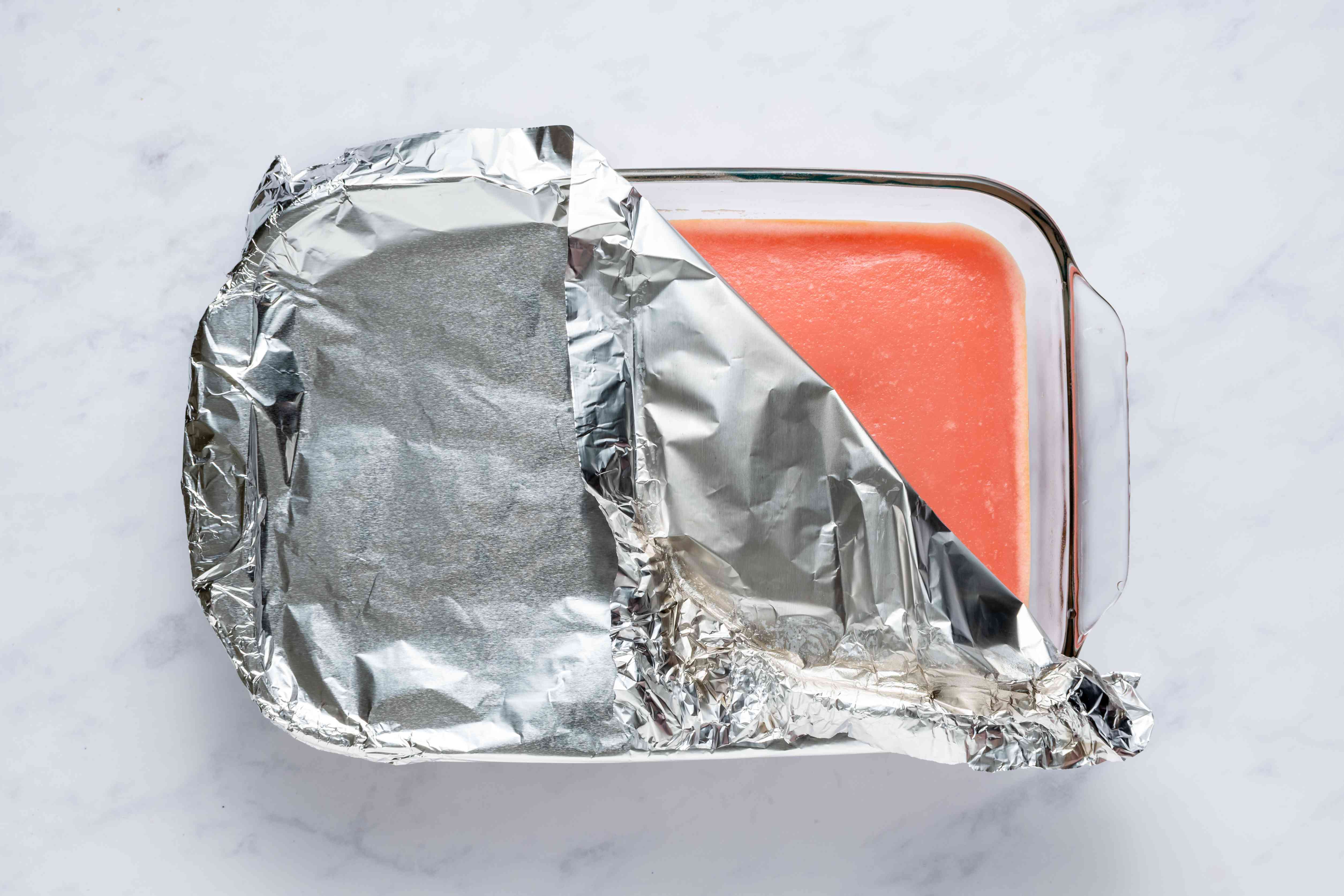 mochiko mixture in a baking dish covered with aluminum foil
