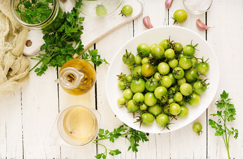 Green tomatoes and pickling ingredients