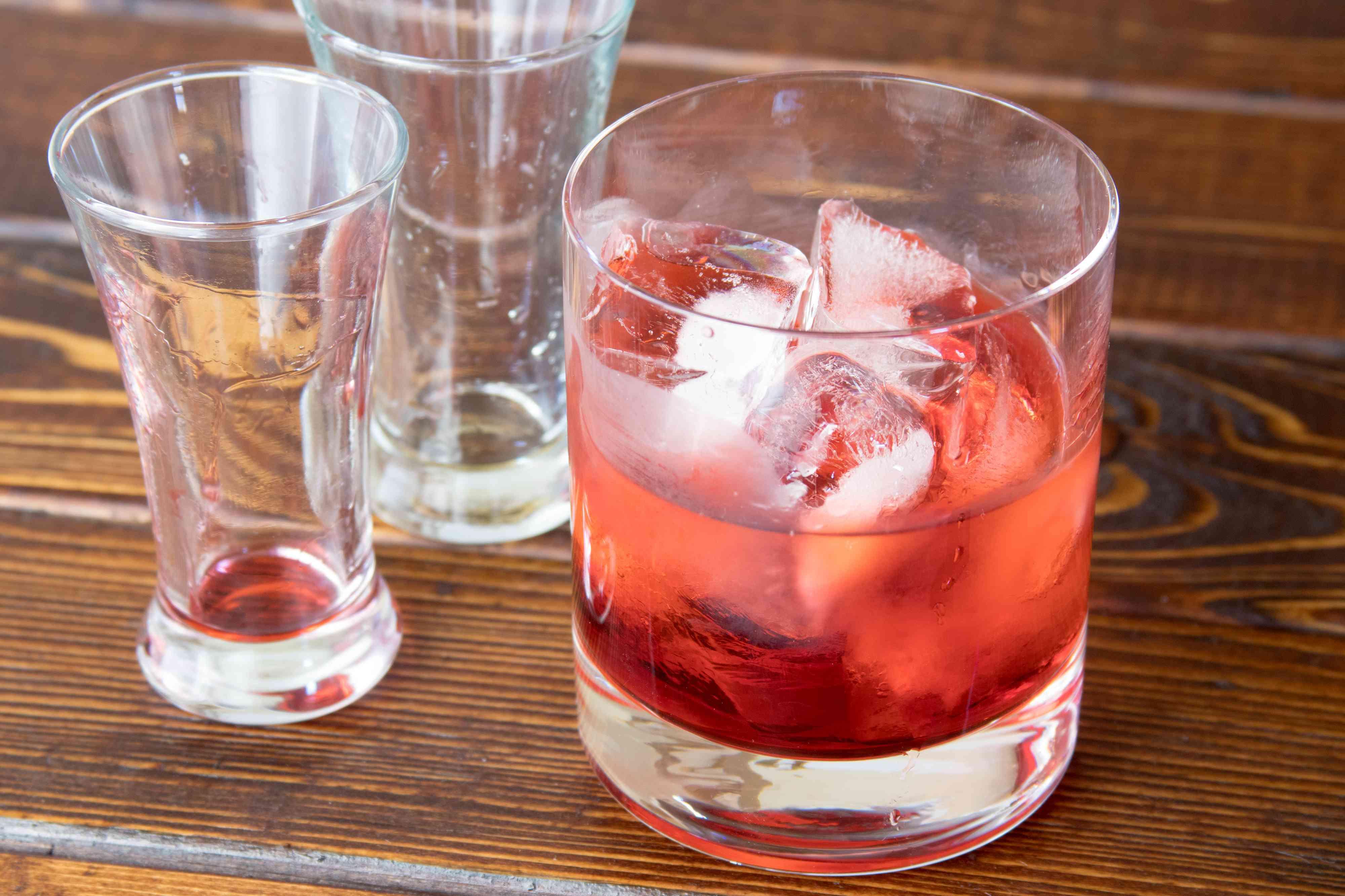 Pouring the hazelnut and raspberry liqueurs