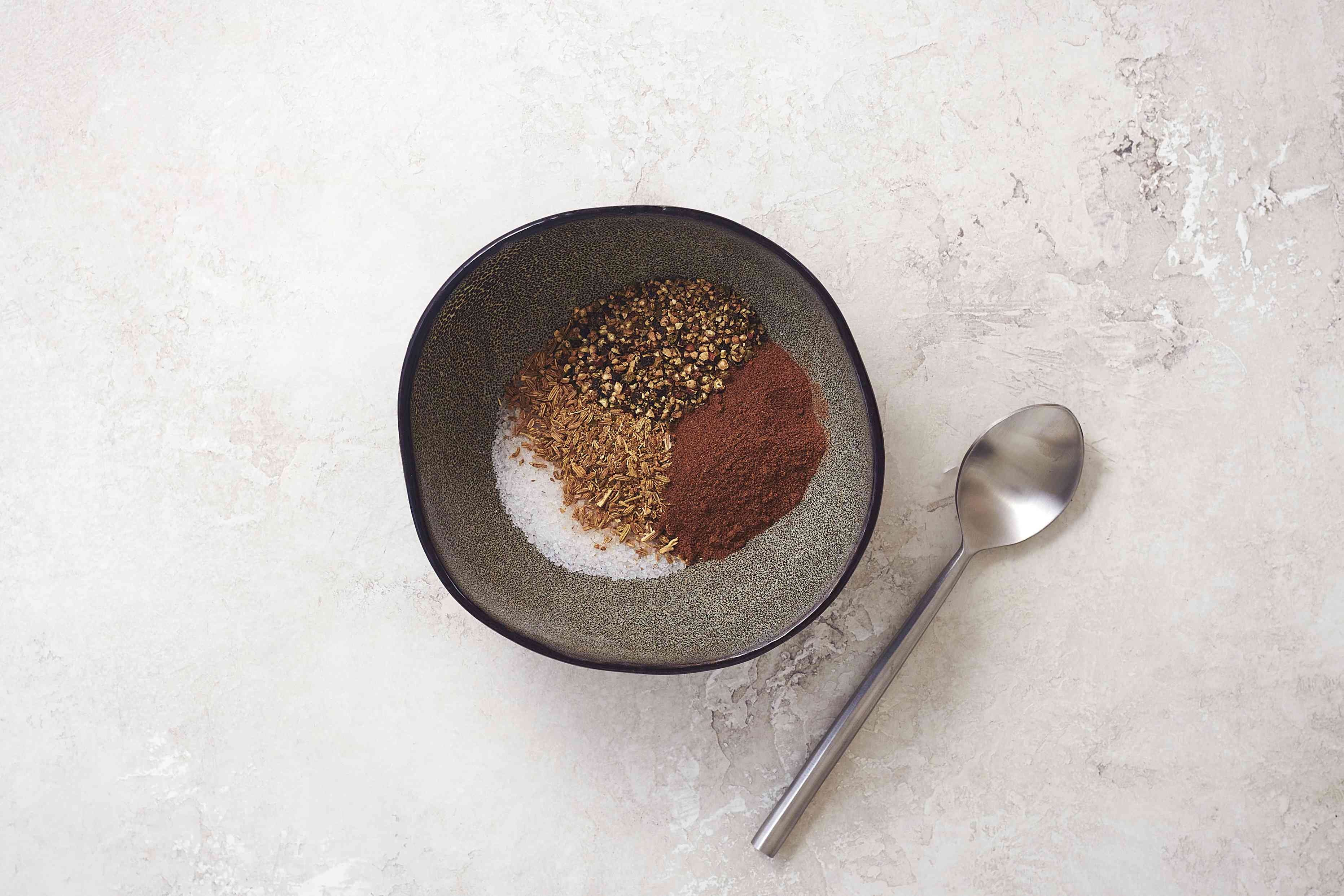 combine the salt, fennel seed, allspice, and black pepper in a bowl