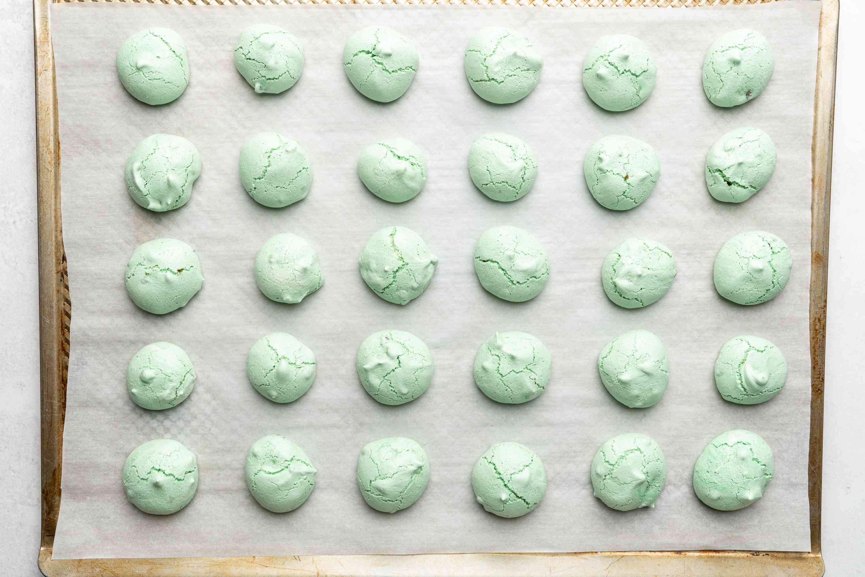 Mint Chocolate Chip Meringue Cookies on a baking sheet