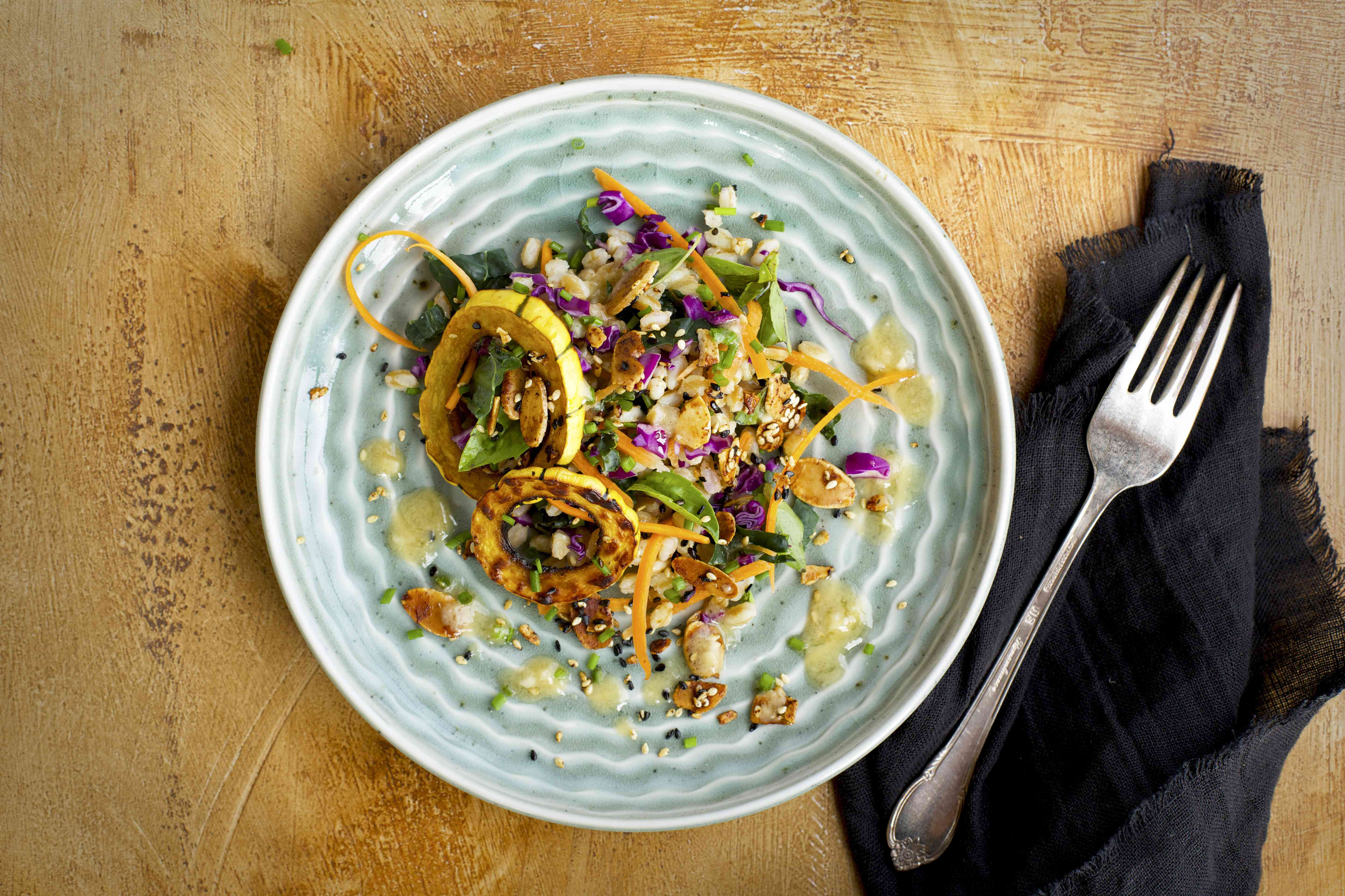 Sesame Farro Salad with Delicata Squash served with dressing, toasted nuts, and chives