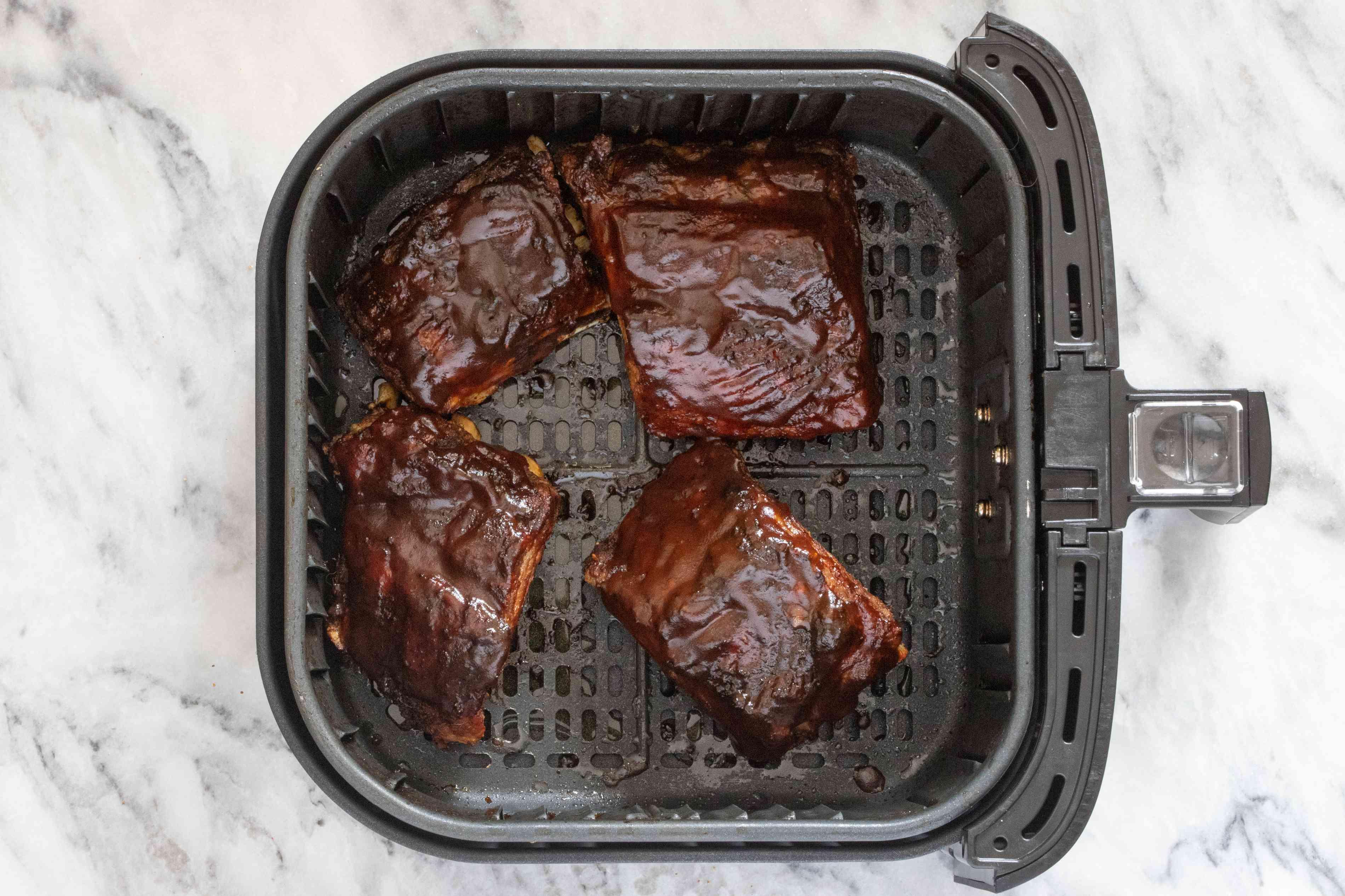 Pork ribs in the air fryer basket