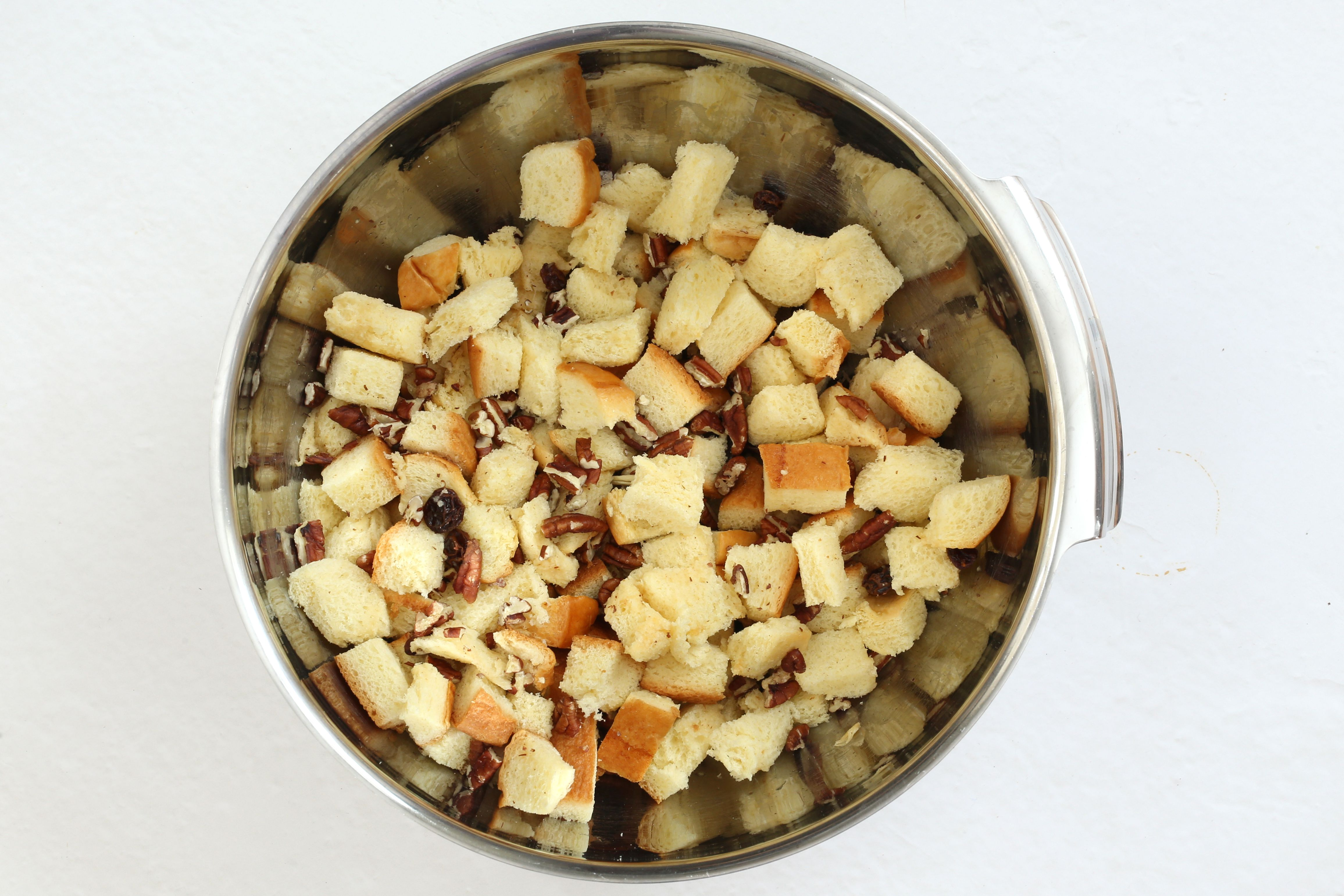 Toss the bread cubes, raisins, and nuts.