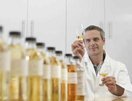 Scientist tasting whiskey in plant