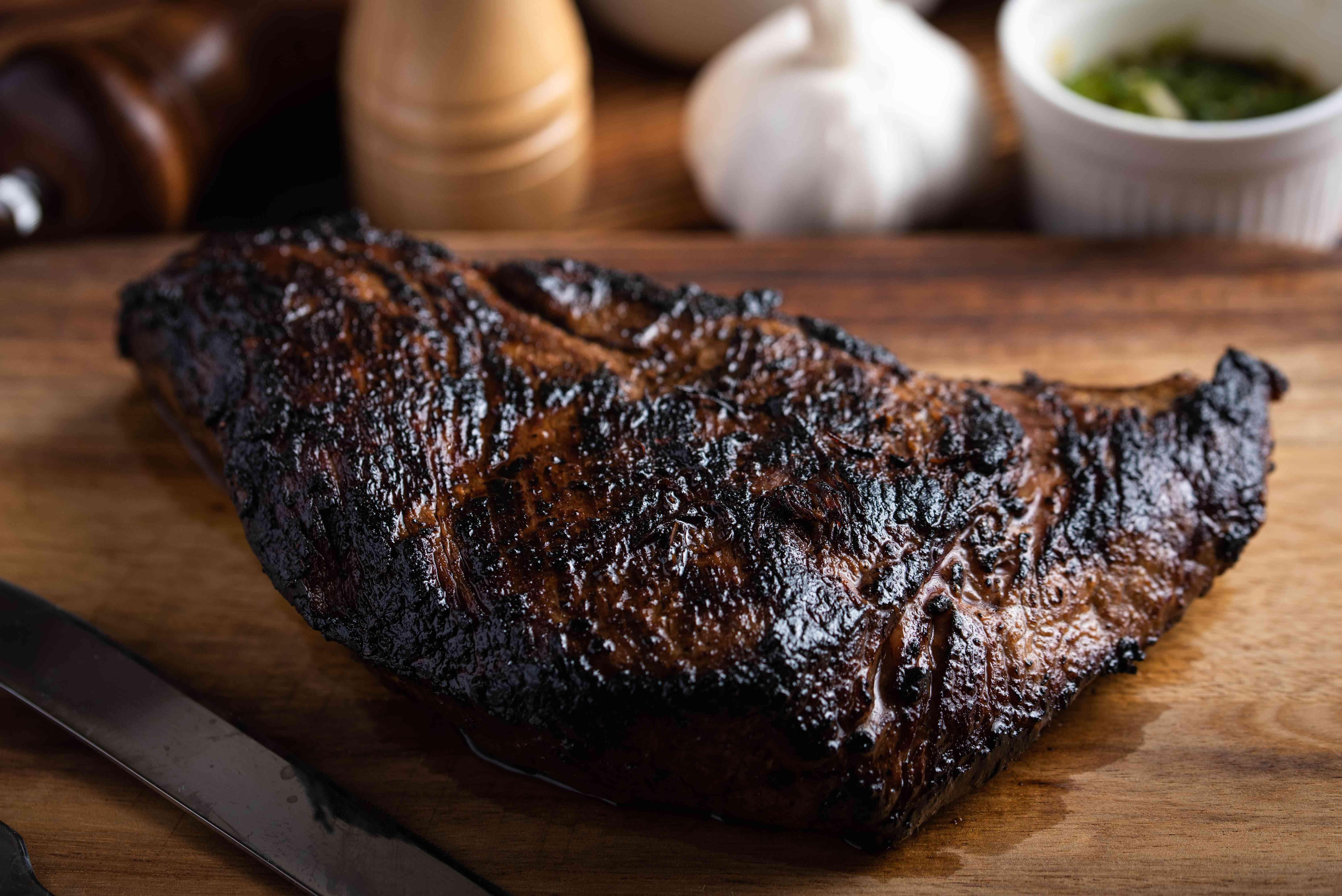 Grilled tri-tip steak on a cutting board