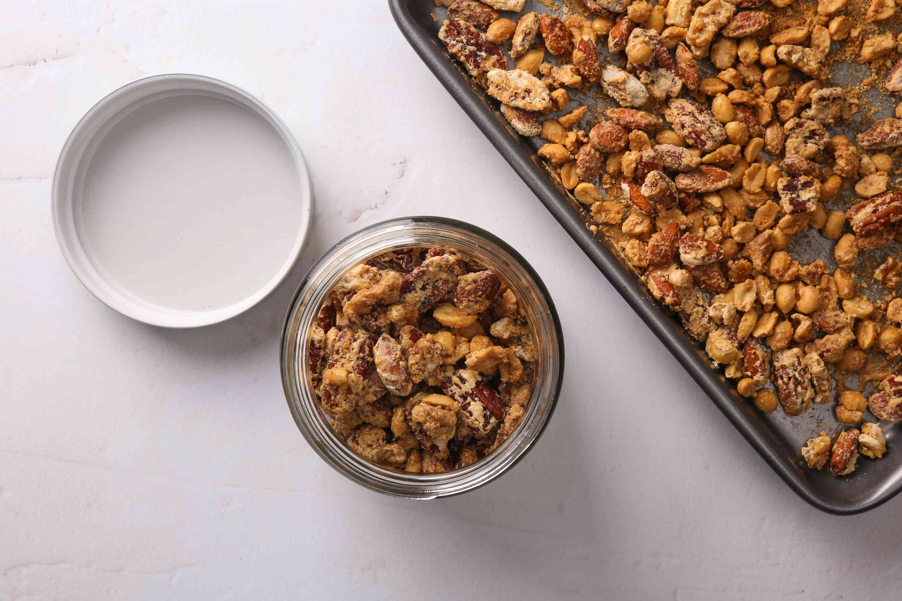 nuts in a jar, nuts on a baking sheet