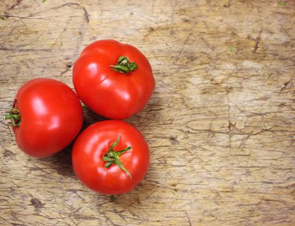Ripe red tomatoes on a wood table