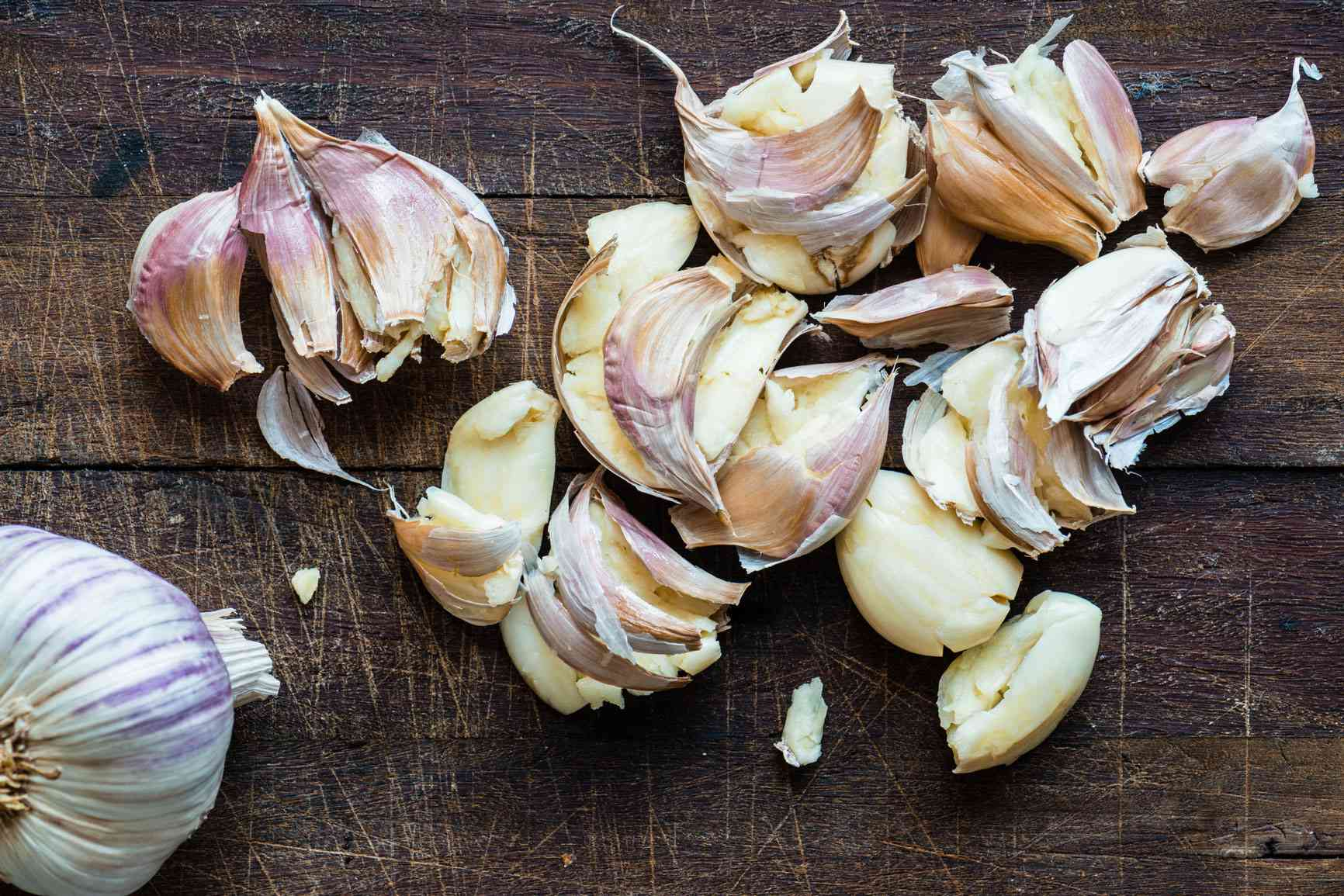 Cloves of garlic scattered on a surface