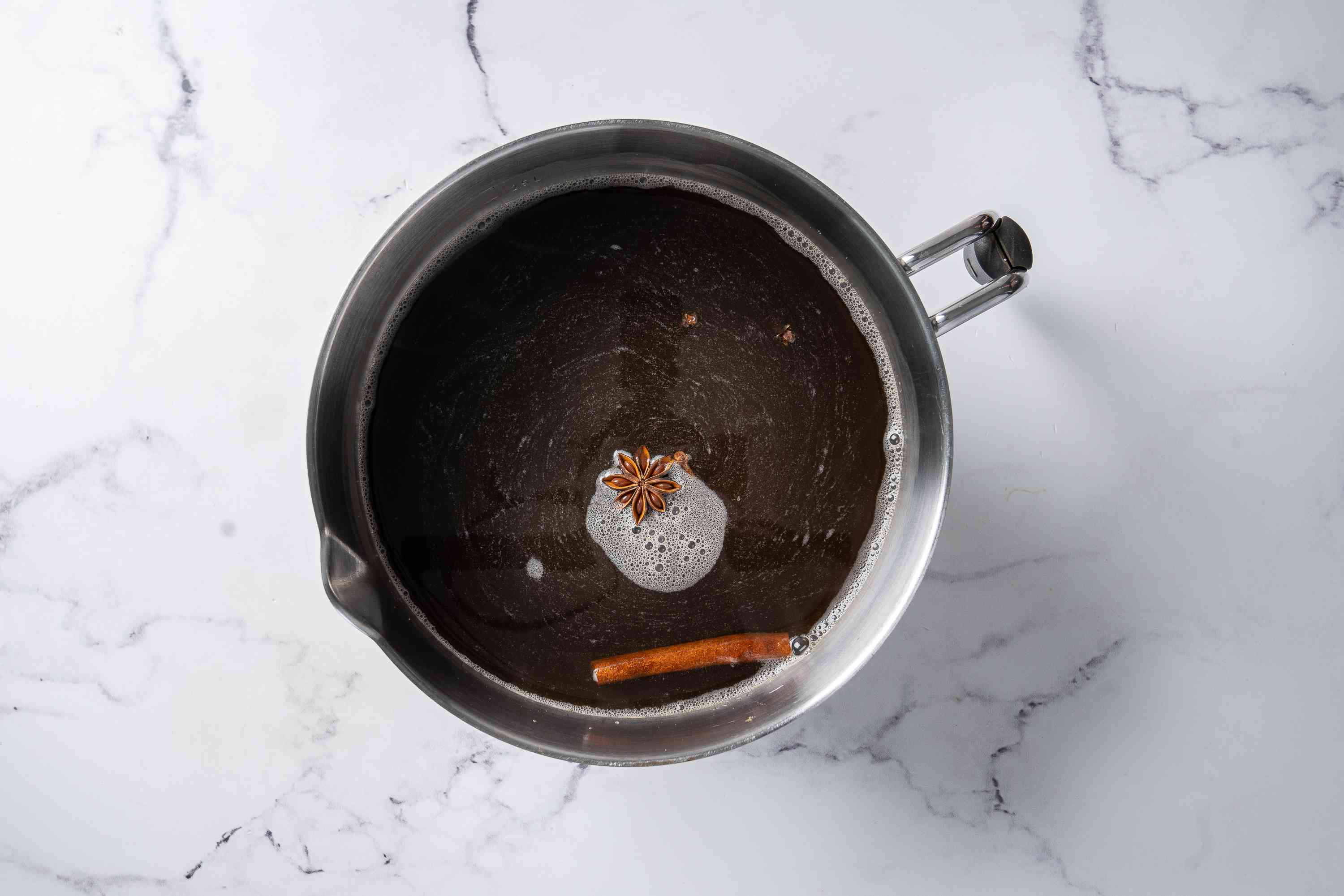 Spices and water in a saucepan