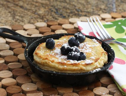 A Dutch baby pancake in a individual, 5-inch cast iron skillet