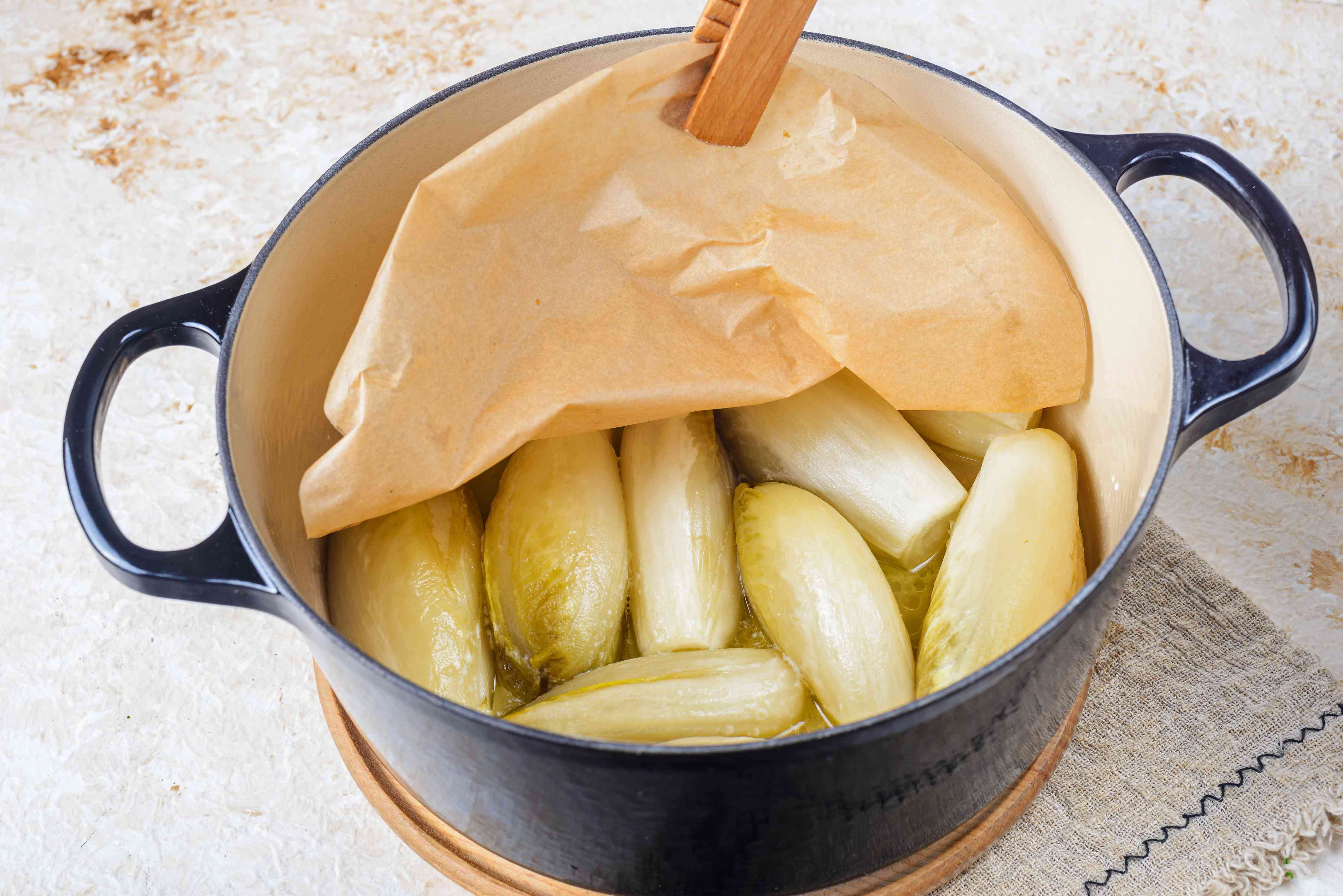 Removing parchment from endives in pot