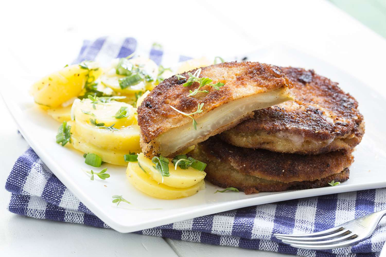 Kohlrabi schnitzel with potato salad, studio shot