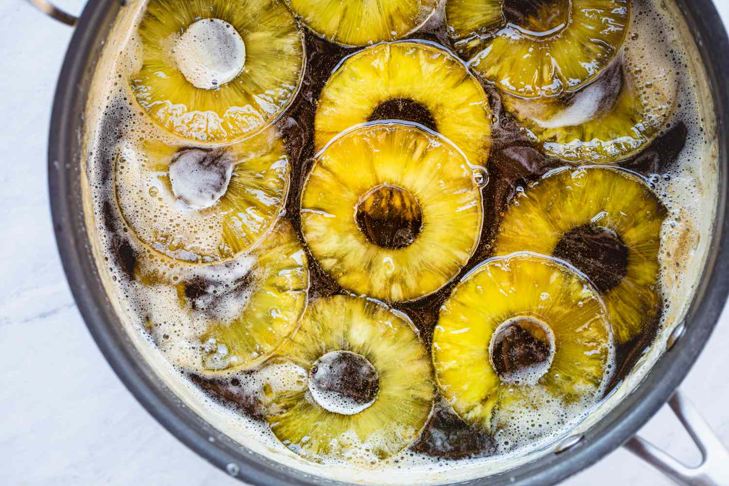 Boil the pineapple in the sugar syrup