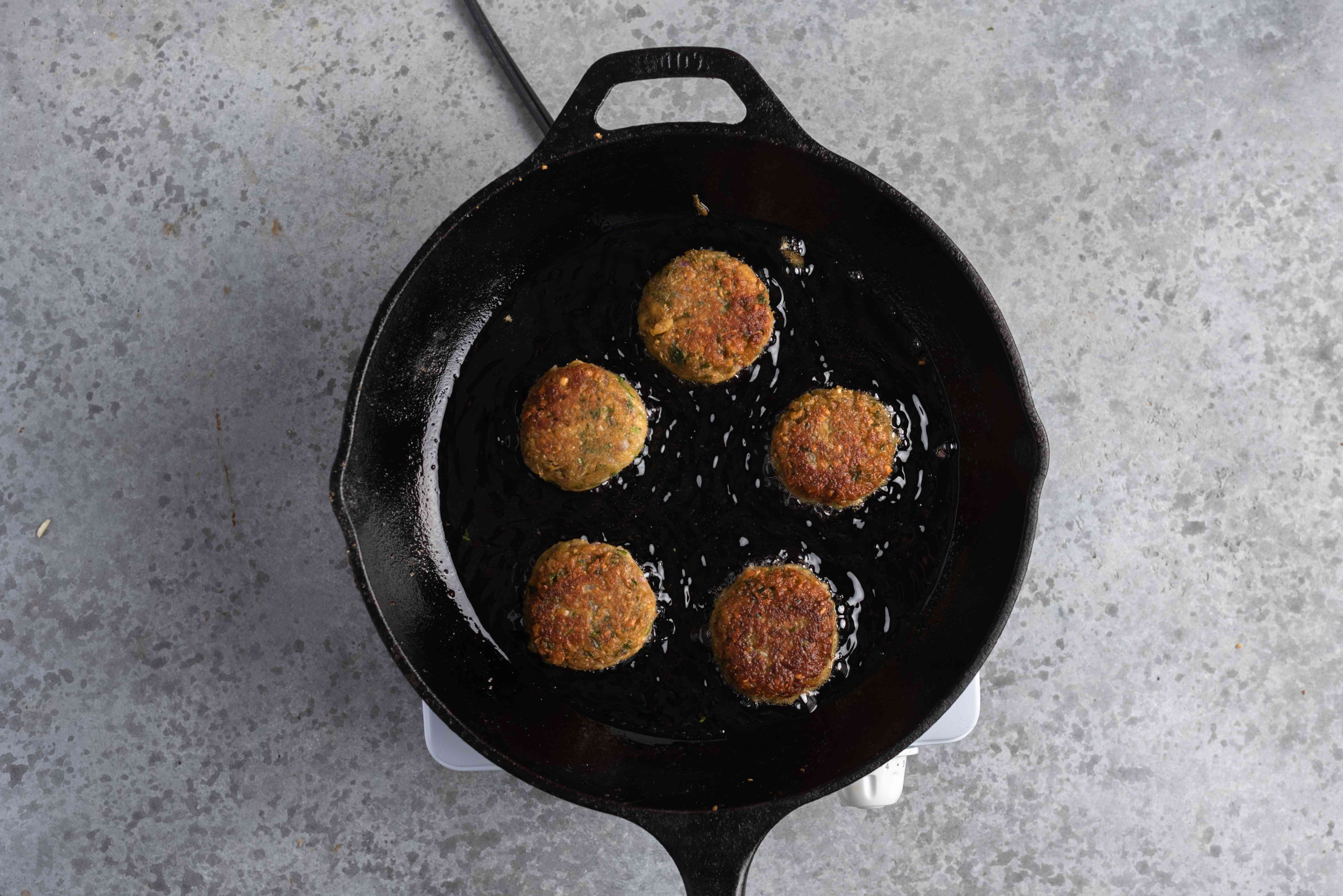 Quick and Easy Falafel frying in a skillet