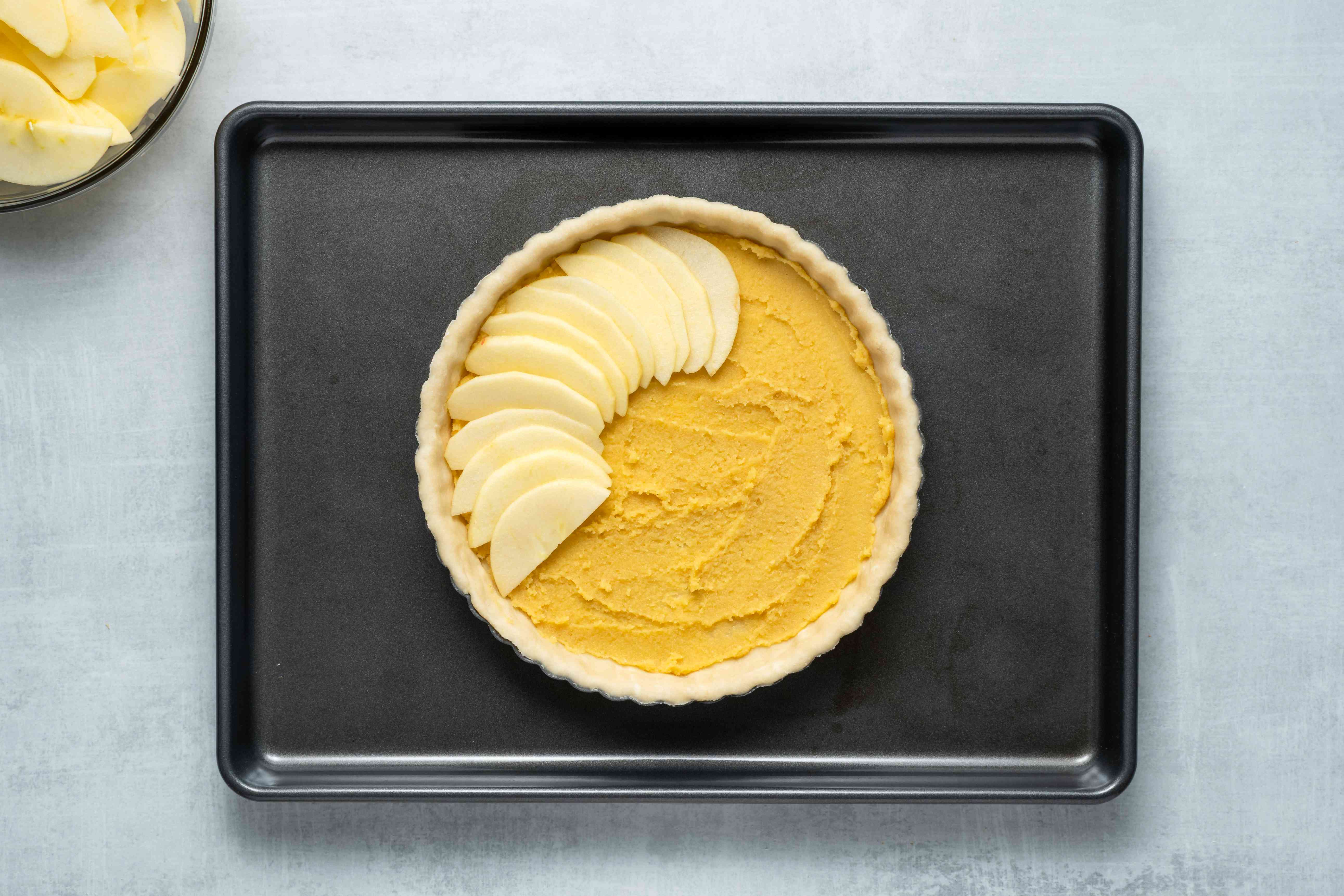 Spread the frangipane evenly over the bottom of the chilled pastry shell, arrange the apple slices in a fan