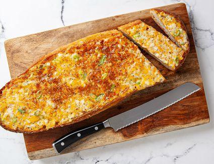 cheesy garlic bread on cutting board