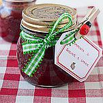 Ready to gift spiced plum jam in a canning jar with a green bow