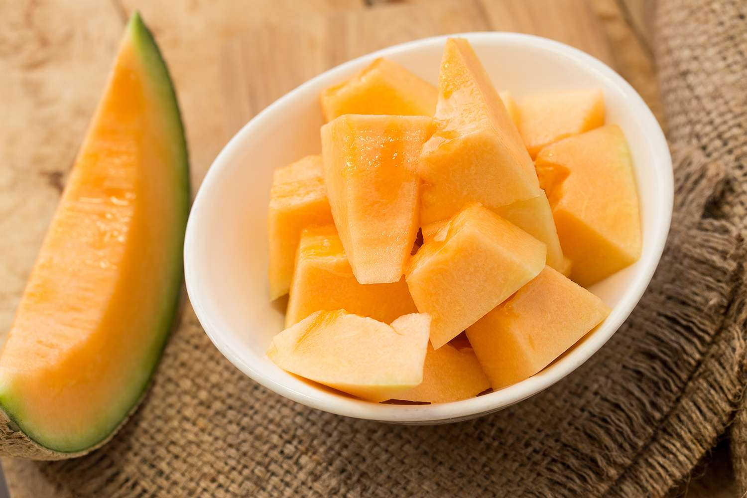 High Angle View Of Cantaloupe Slices On Table