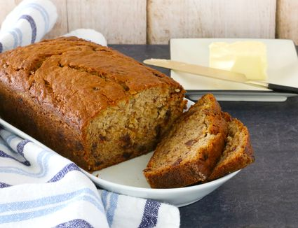 Banana bread on a tray with butter.