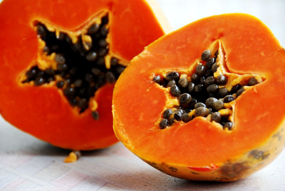Half cut fresh papaya with star shape heart with seeds.