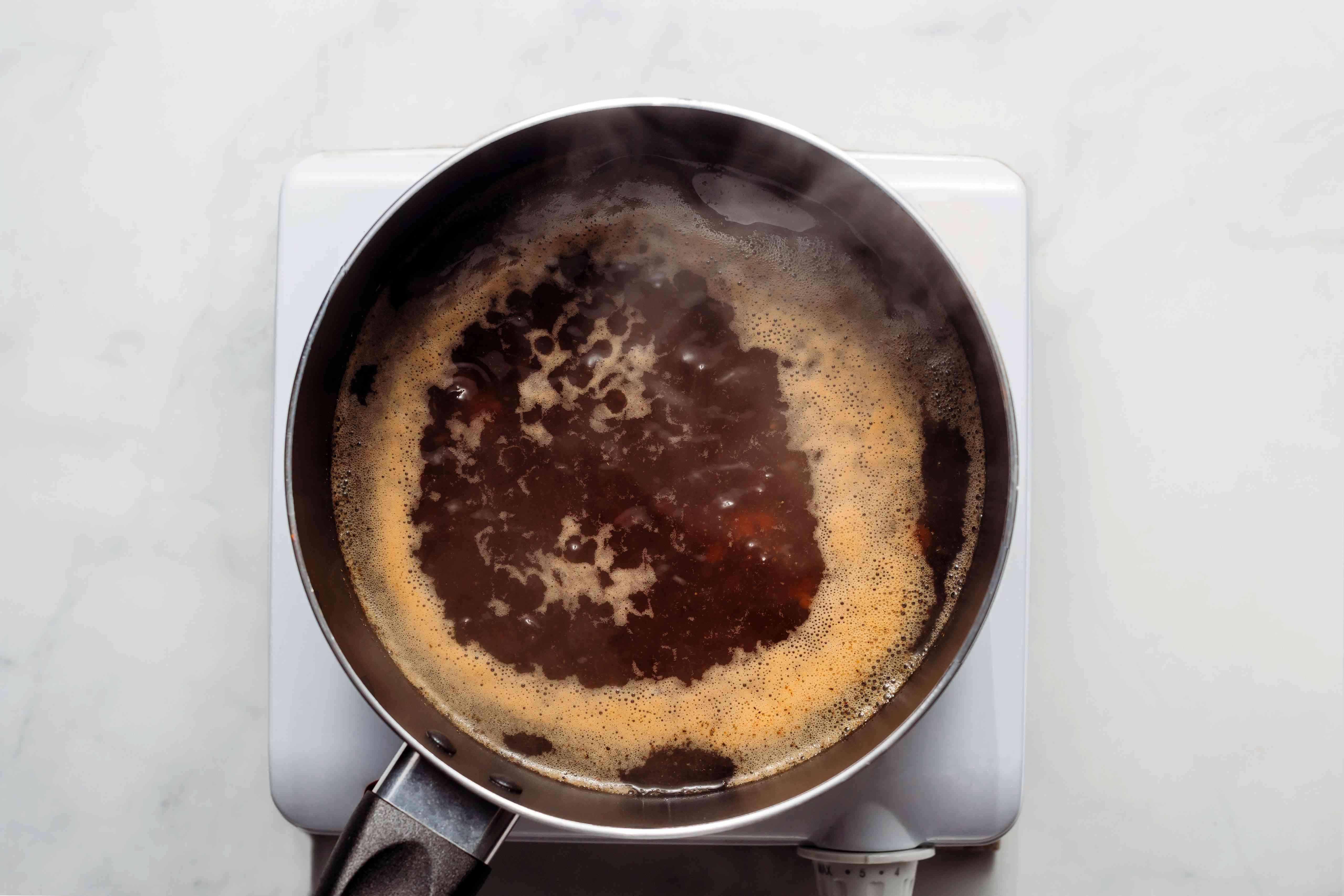 gravy broth in a saucepan