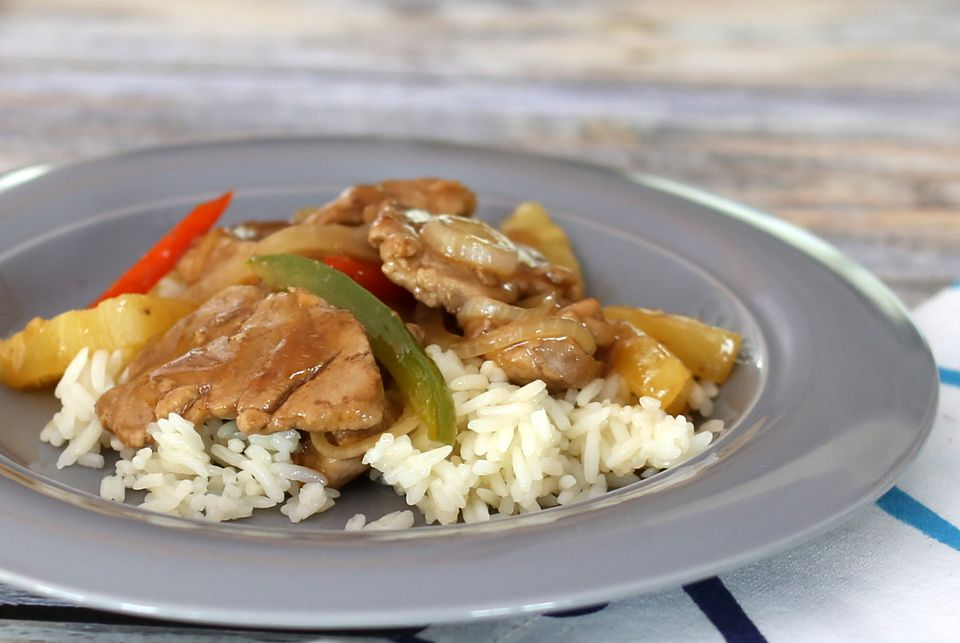 Sweet and sour pork with pineapple over rice