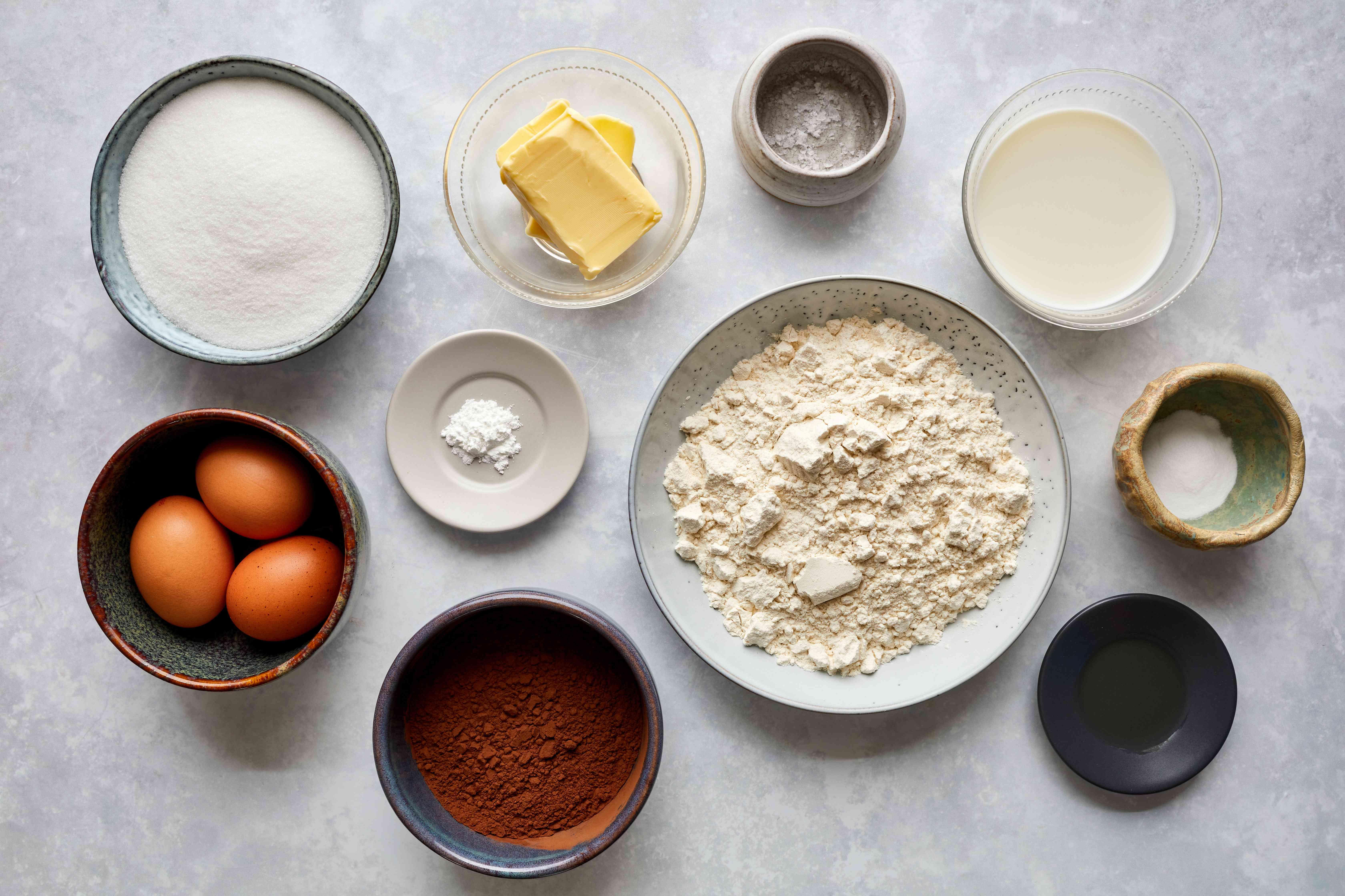 Chocolate Loaf Cake With Easy Chocolate Glaze ingredients, flour, eggs, butter, sugar, salt, baking soda, baking powder, cocoa powder, milk, vanilla extract, salt
