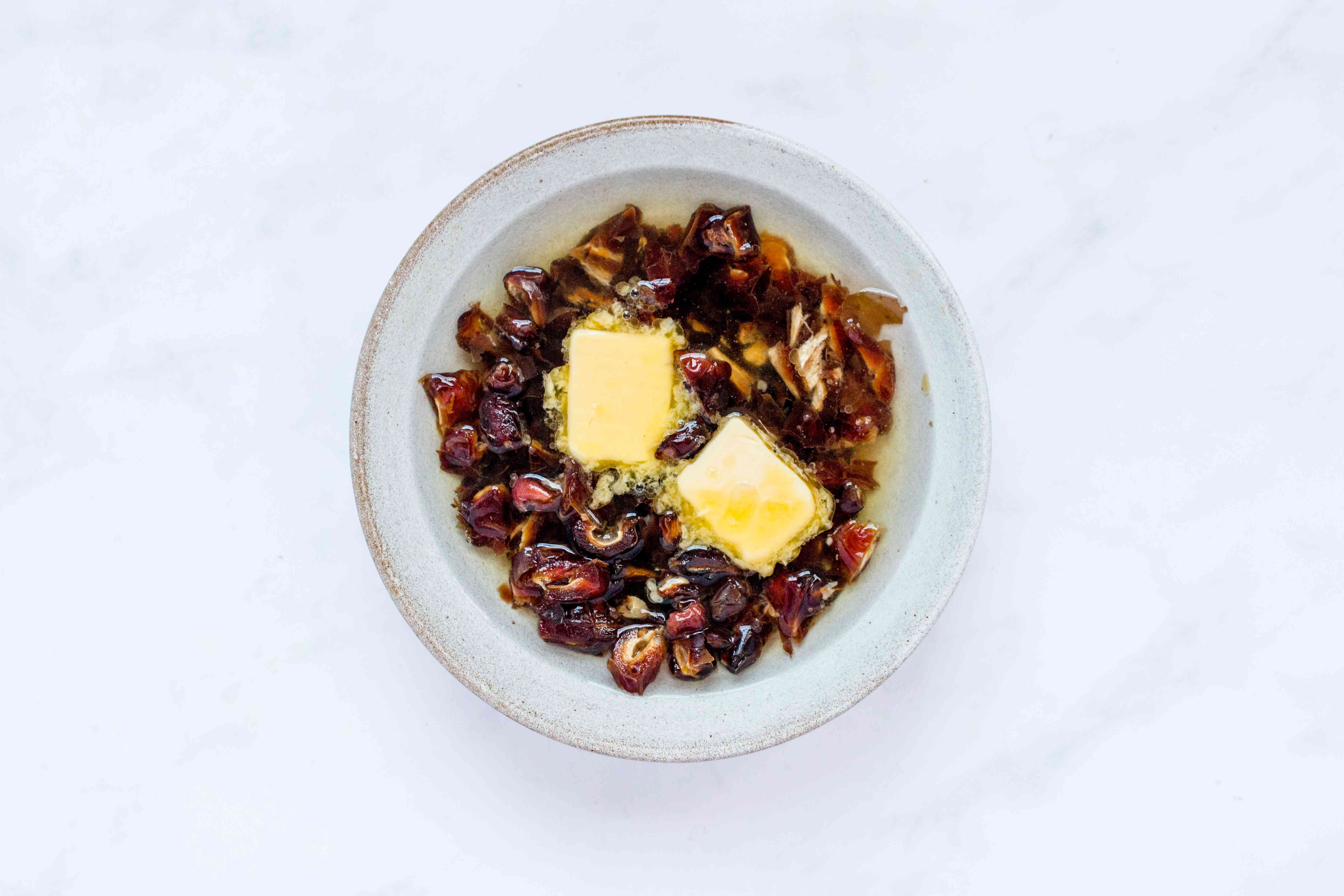 pour the boiling water over the chopped dates in bowl, and add butter