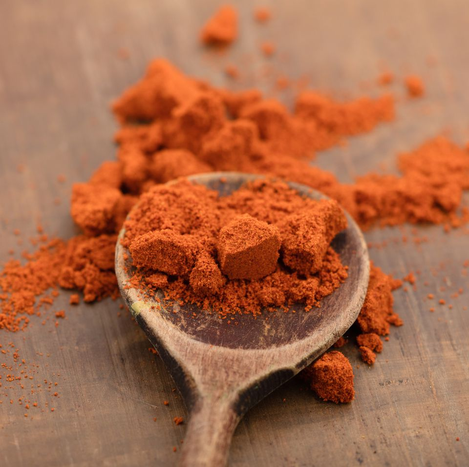 Paprika in a wooden spoon