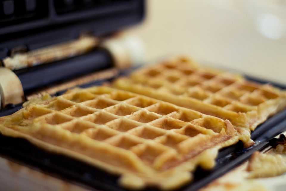 Waffle iron with fresh golden waffles