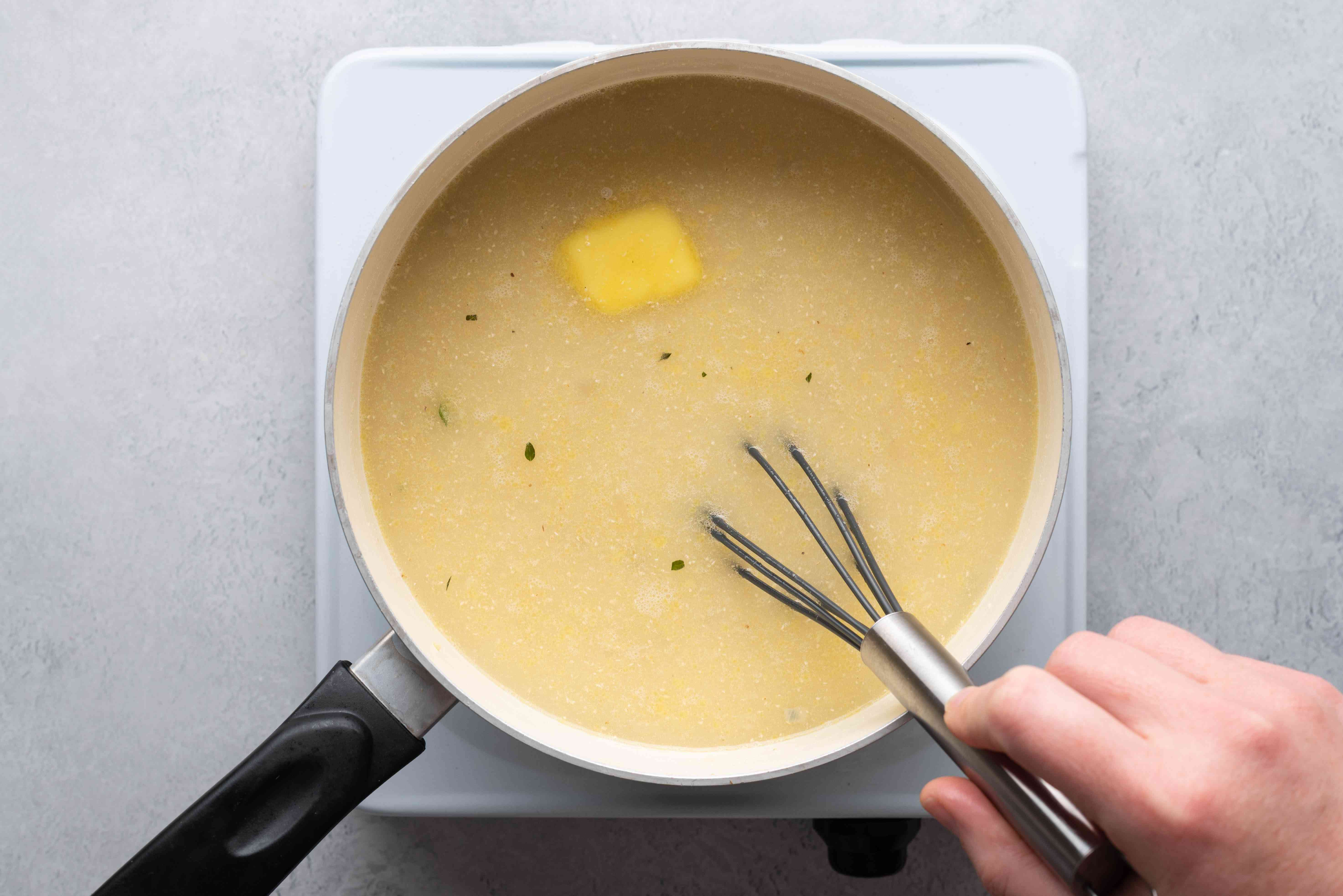 cornmeal, butter and okra liquid in a pot