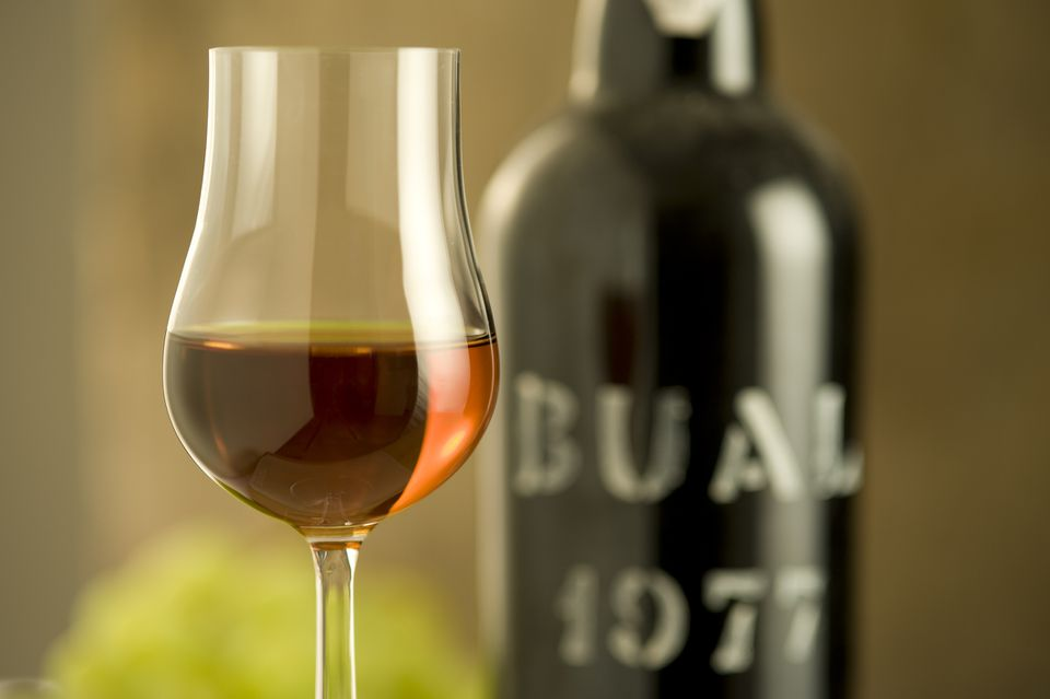 Glass of madeira wine and bottle