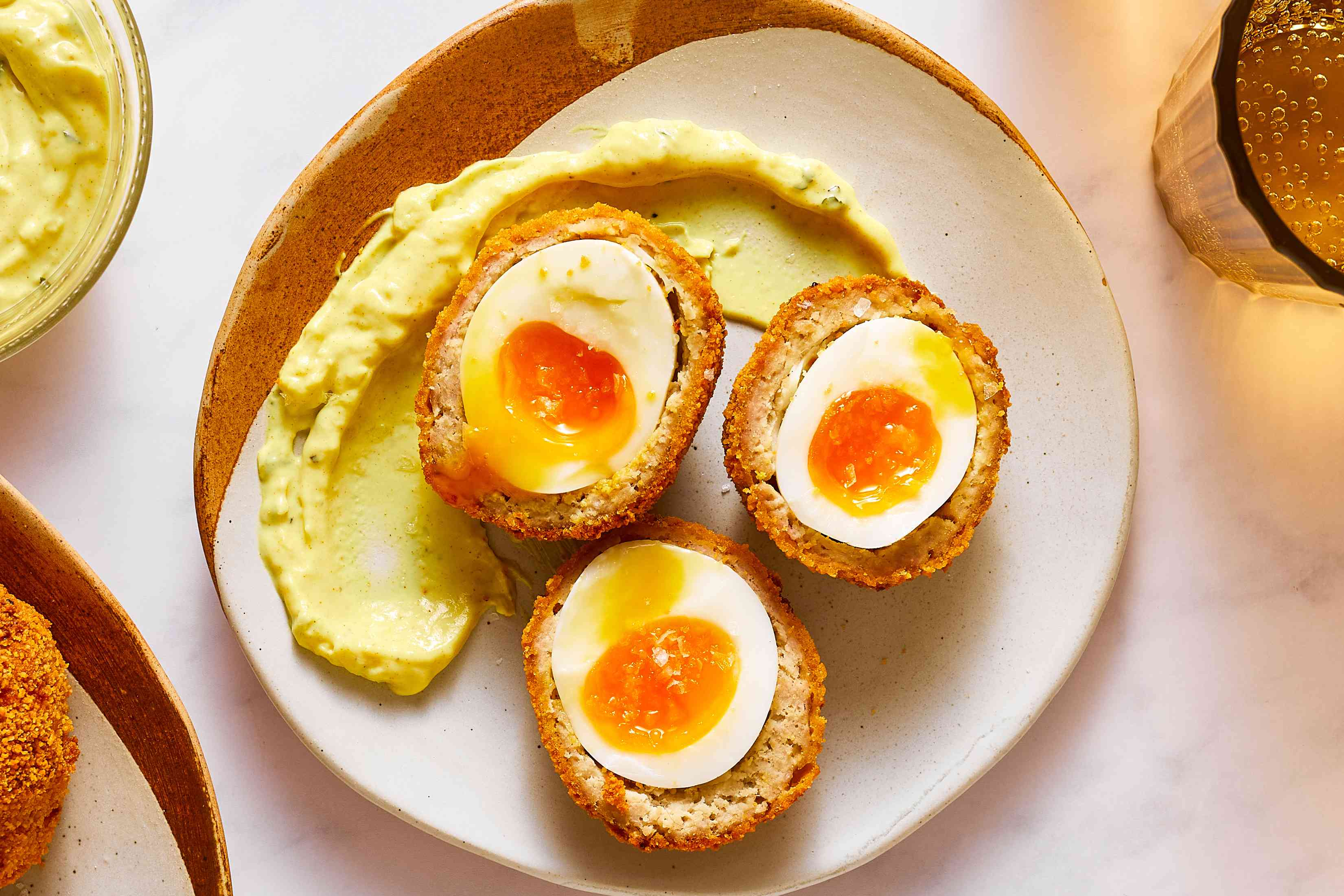 cooked scotch eggs on a plate
