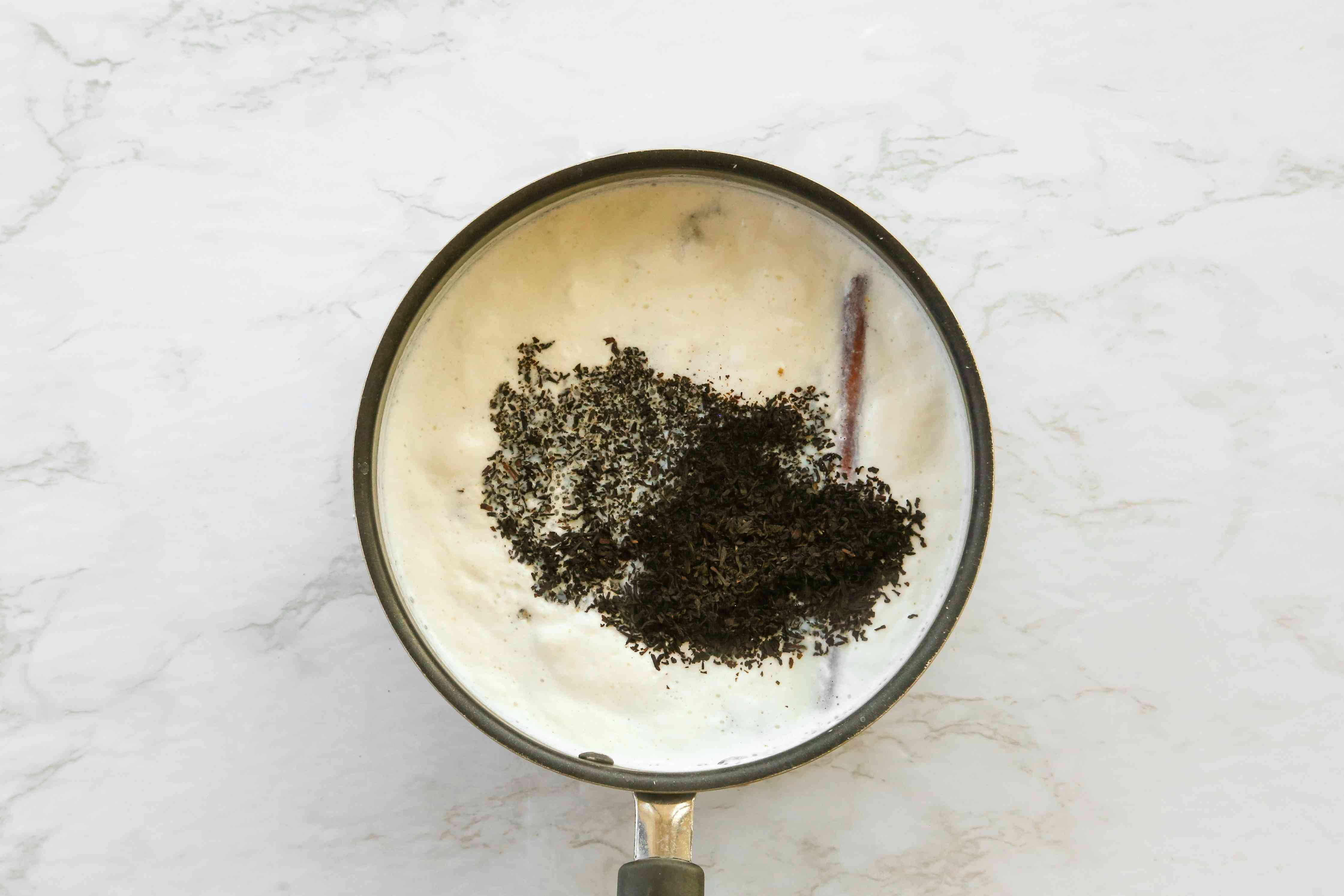 Add the sugar and tea leaves to the mixture in the saucepan
