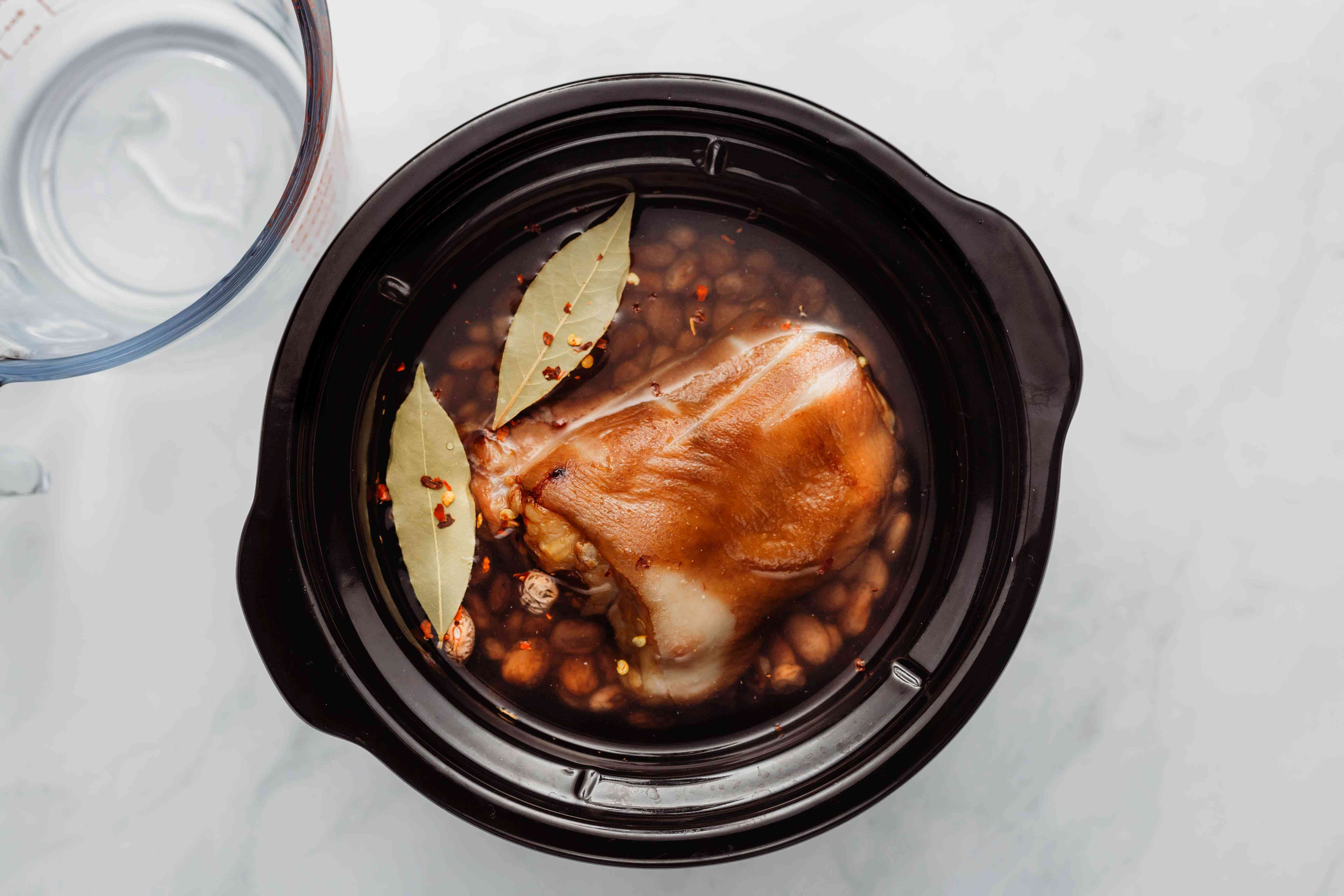 Beans and ham hocks in the crock pot covered with water