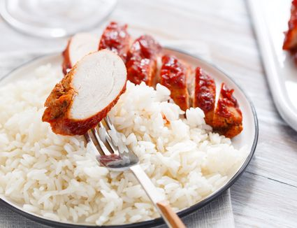 Oven barbecued chicken breast on top of rice