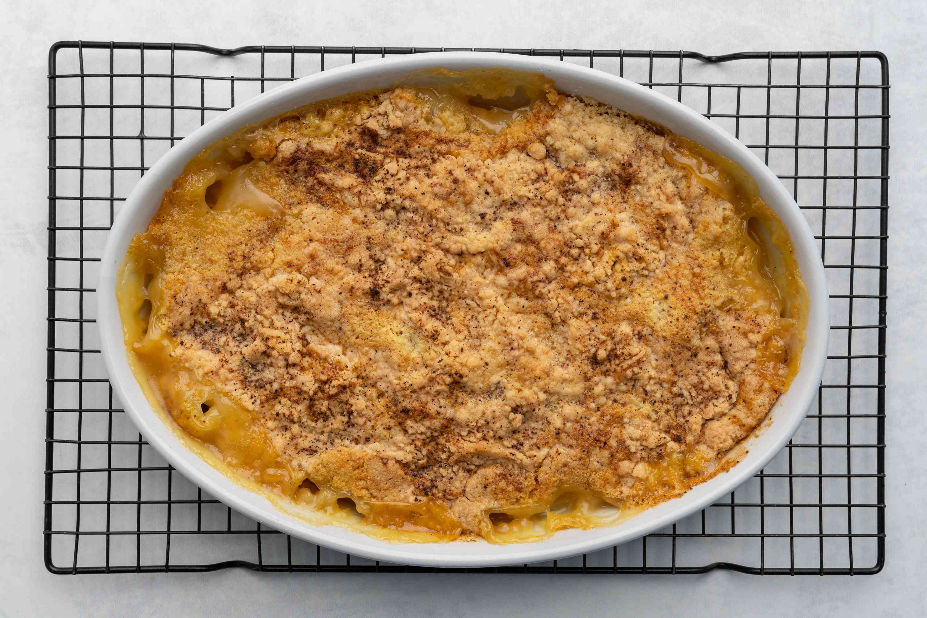 Canned Pear Cobbler Made With Cake Mix in a baking dish on a cooling rack