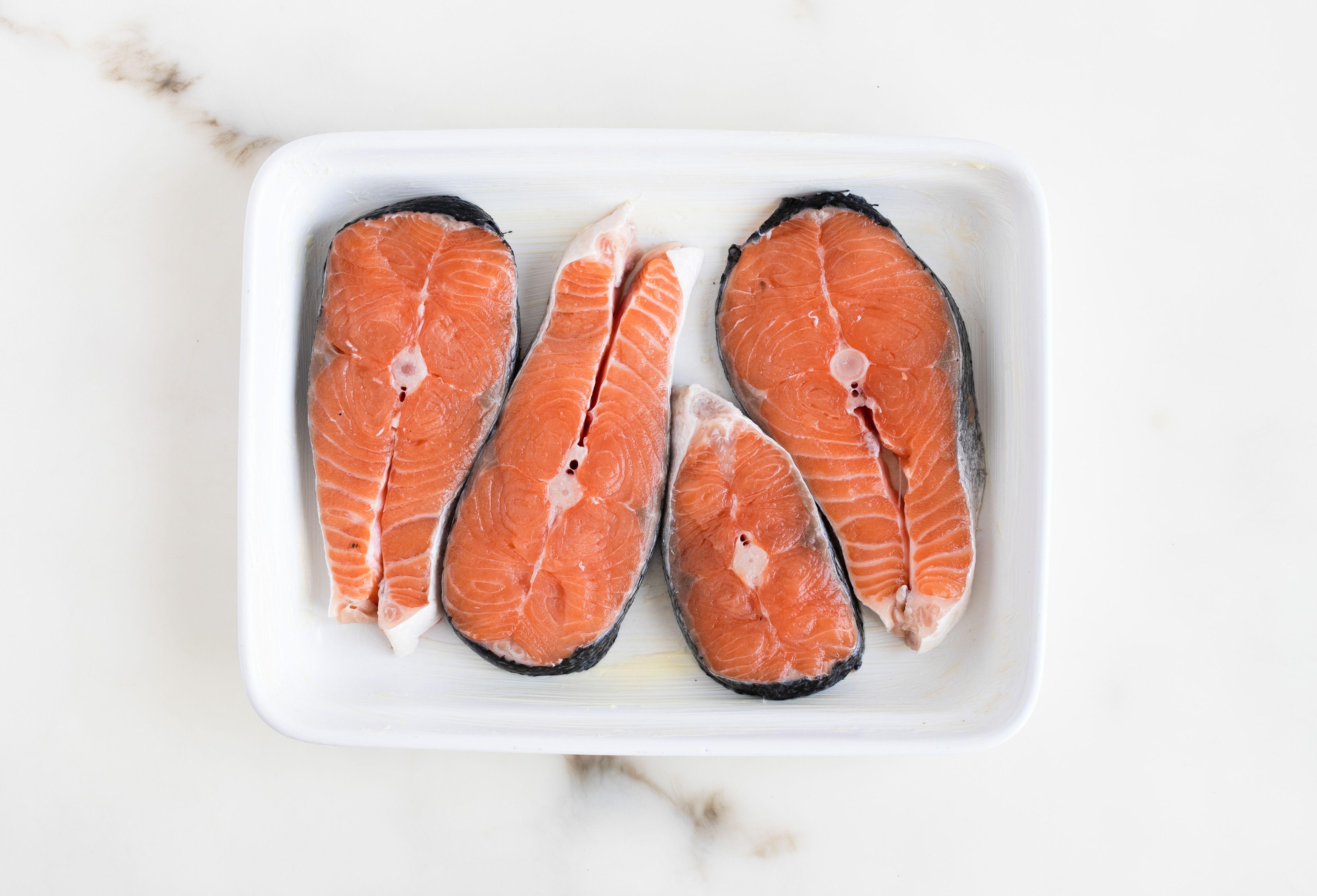 Arrange salmon in dish