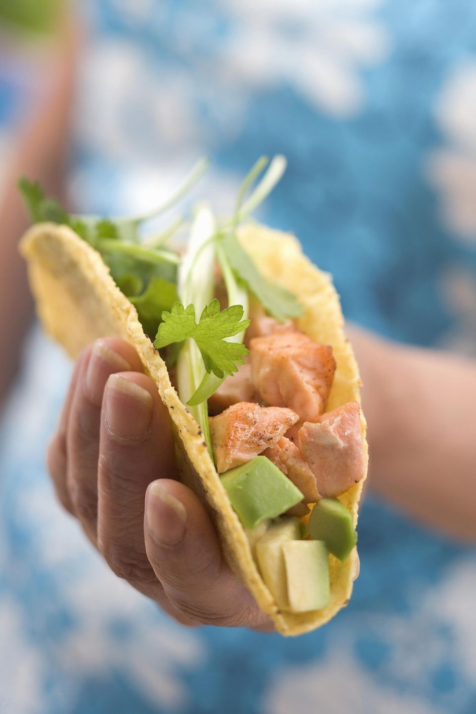 Woman holding taco