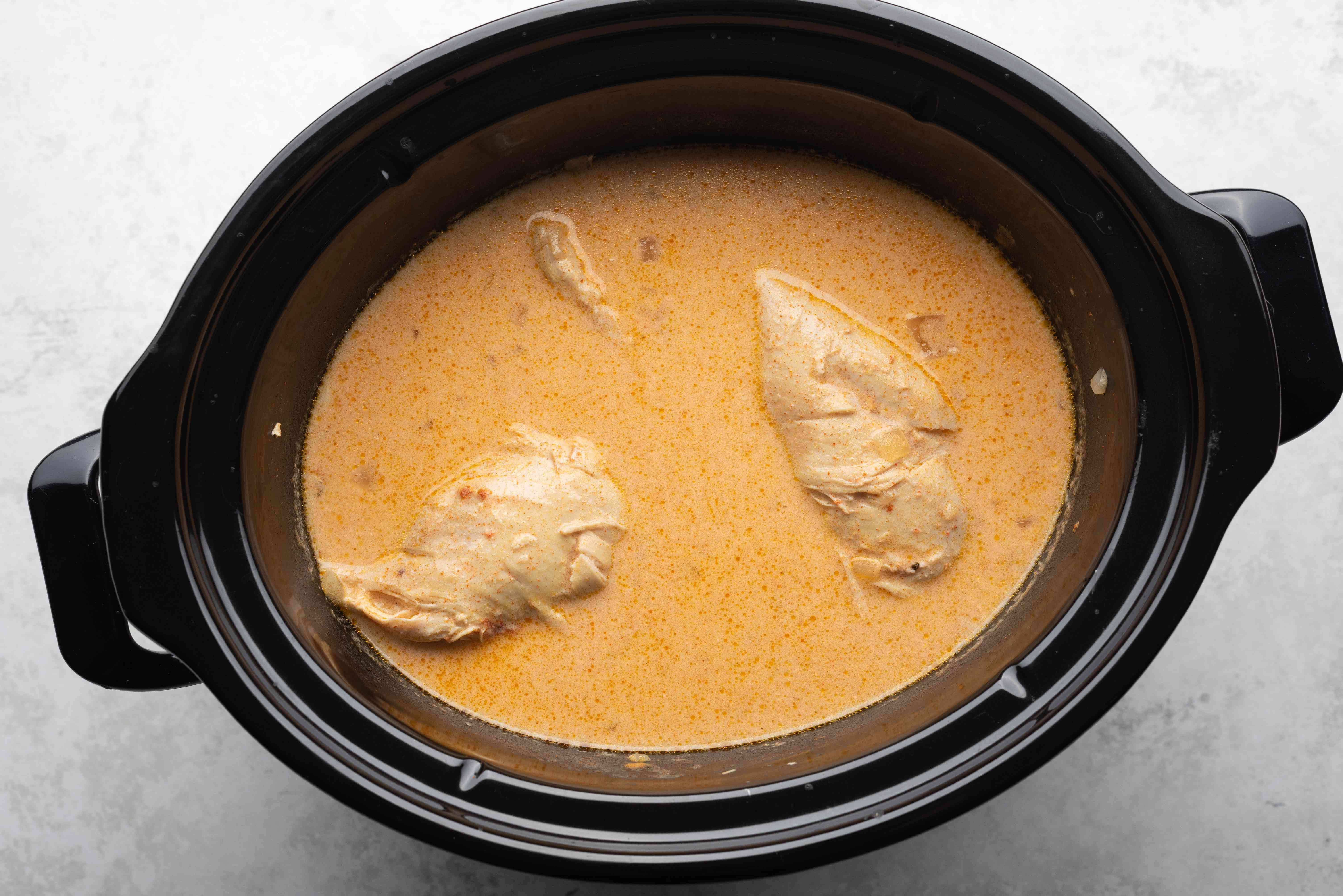 cooked chicken in a slow cooker
