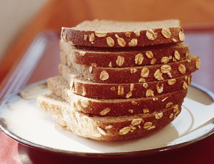 Stack of sliced oatmeal bread